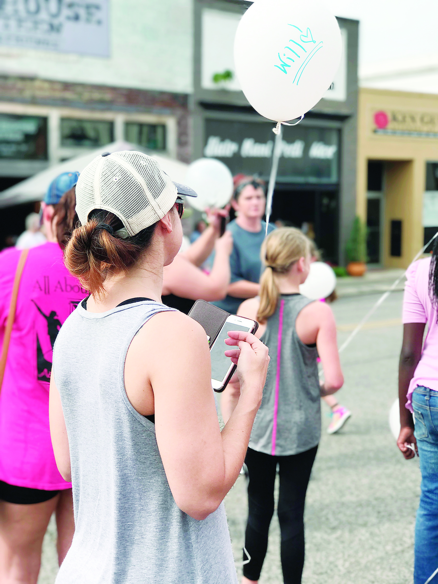 A participant in the 2017 Walk for Hope prepares to release a balloon in memory of a loved one lost to addiction.
