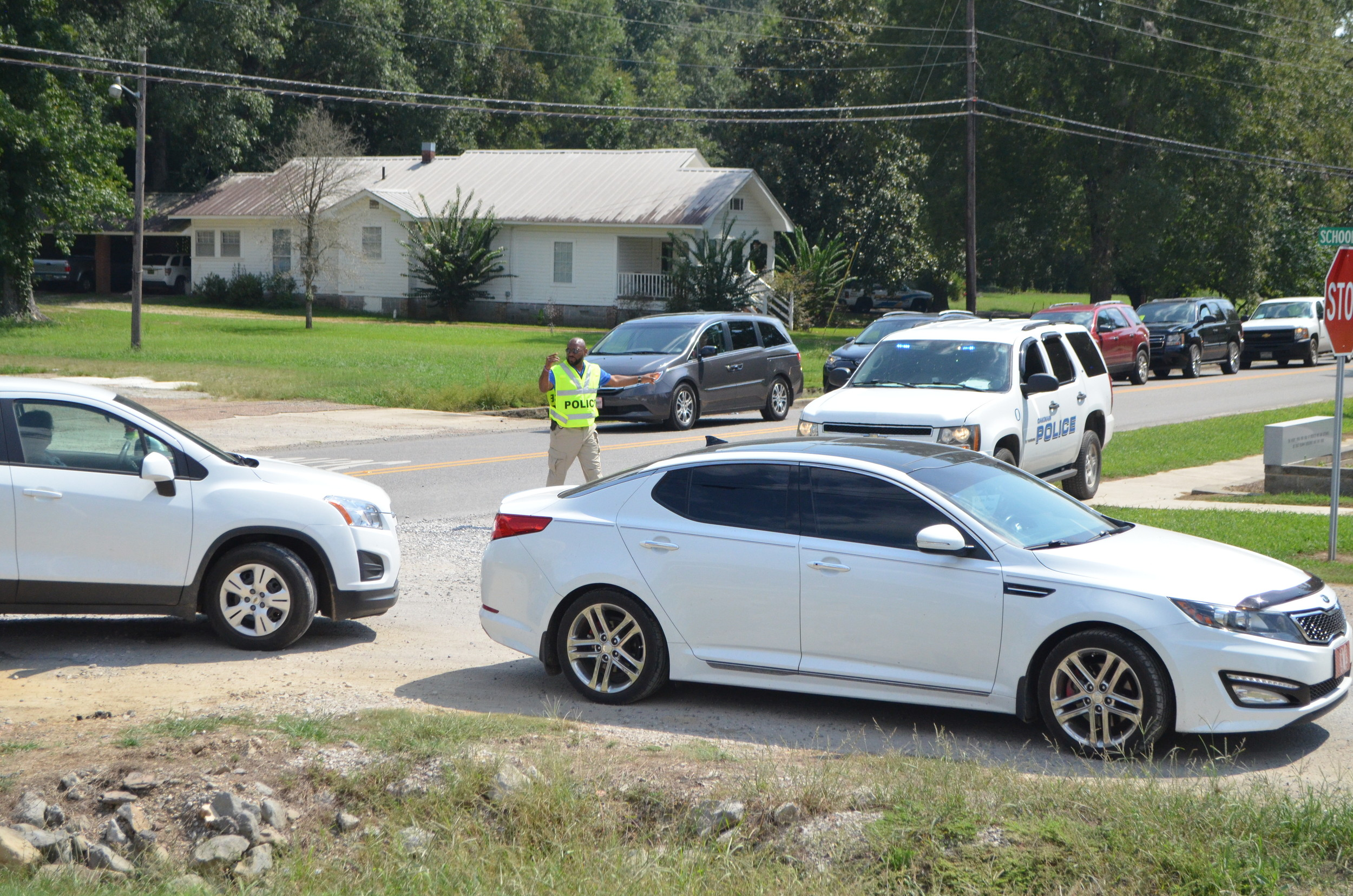 Oakman Police Chief Ken Marbury works to direct school traffic off a busy Highway 69 prior to a new plan currently being implemented that has alleviated backed up traffic on the state highway.