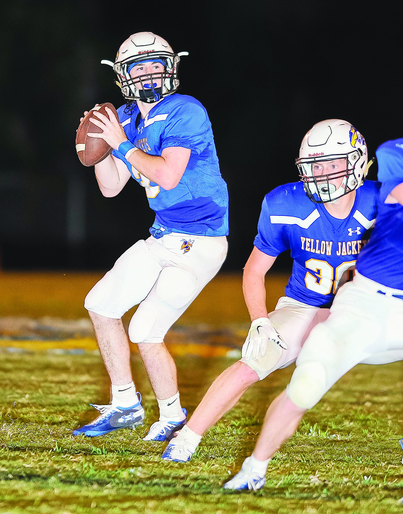 Curry's Luke Smith looks to pass against Oakman on Friday night. Smith competed 13 of 25 passes for 103 yards with a touchdown and an interception in Curry's 17-14 victory.