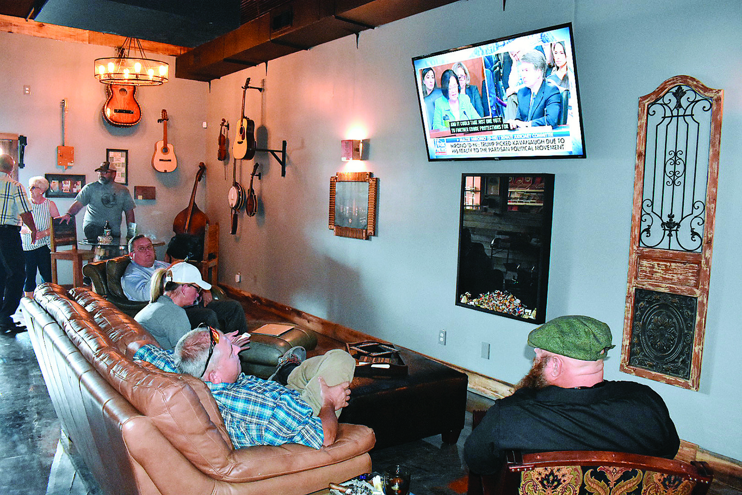 The cigar lounge in The Cigar Box in downtown Jasper features leather chairs, large TVs and a system to quickly eliminate cigar smoke and circulate fresh air.