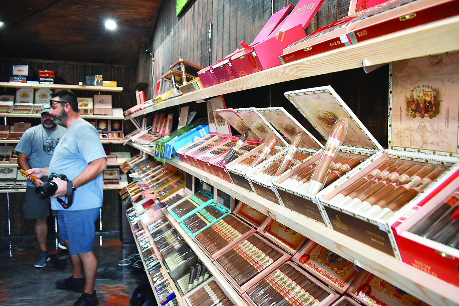 A large number of hand-rolled cigars are displayed at the Cigar Box prior to its ribbon-cutting ceremony on Tuesday.