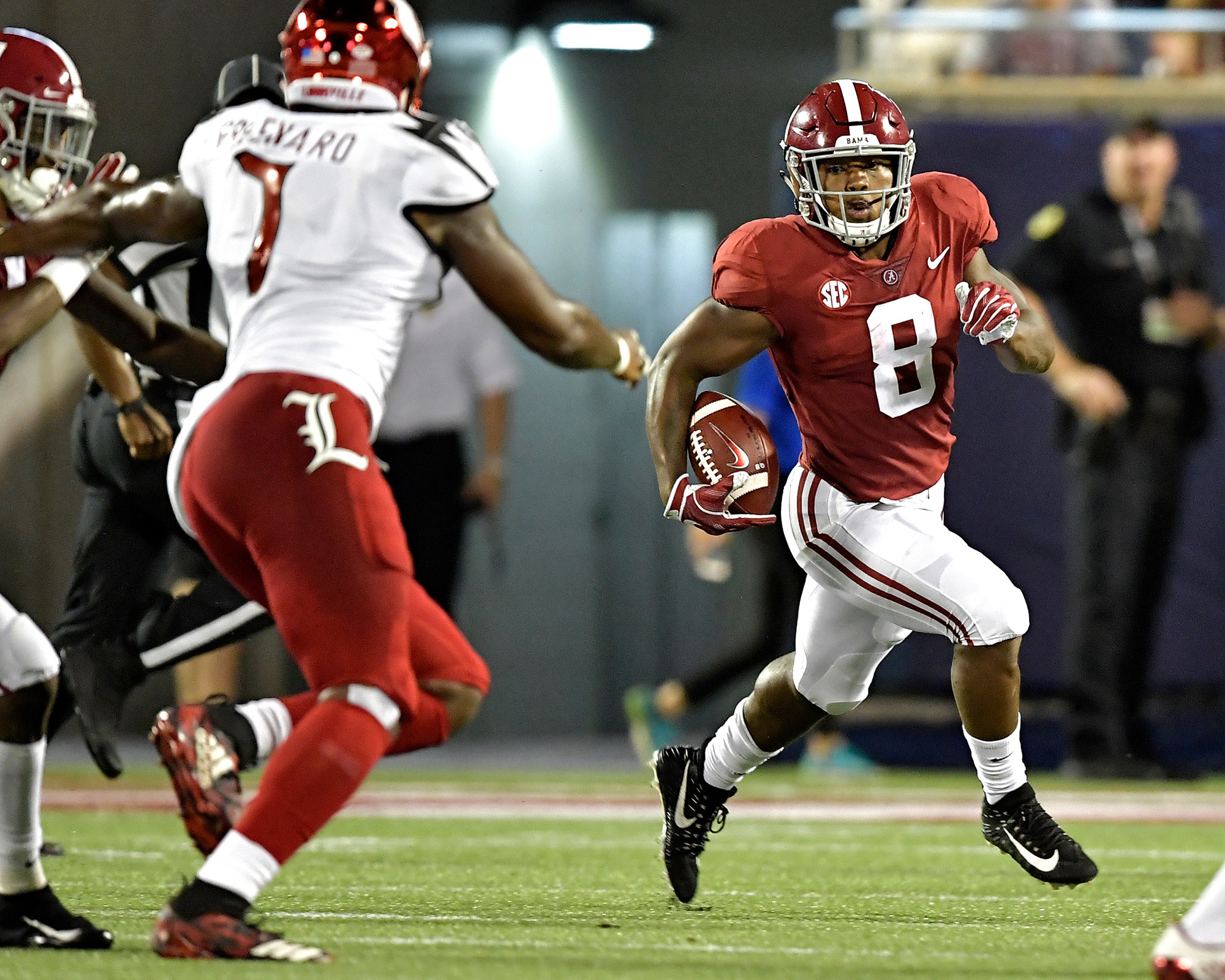 Alabama Crimson Tide running back Josh Jacobs (8) with a carry during the first half of the Camping World Kickoff football game on Saturday, Sept. 1, 2018, in Orlando, Fla. (Photo by Lee Walls)