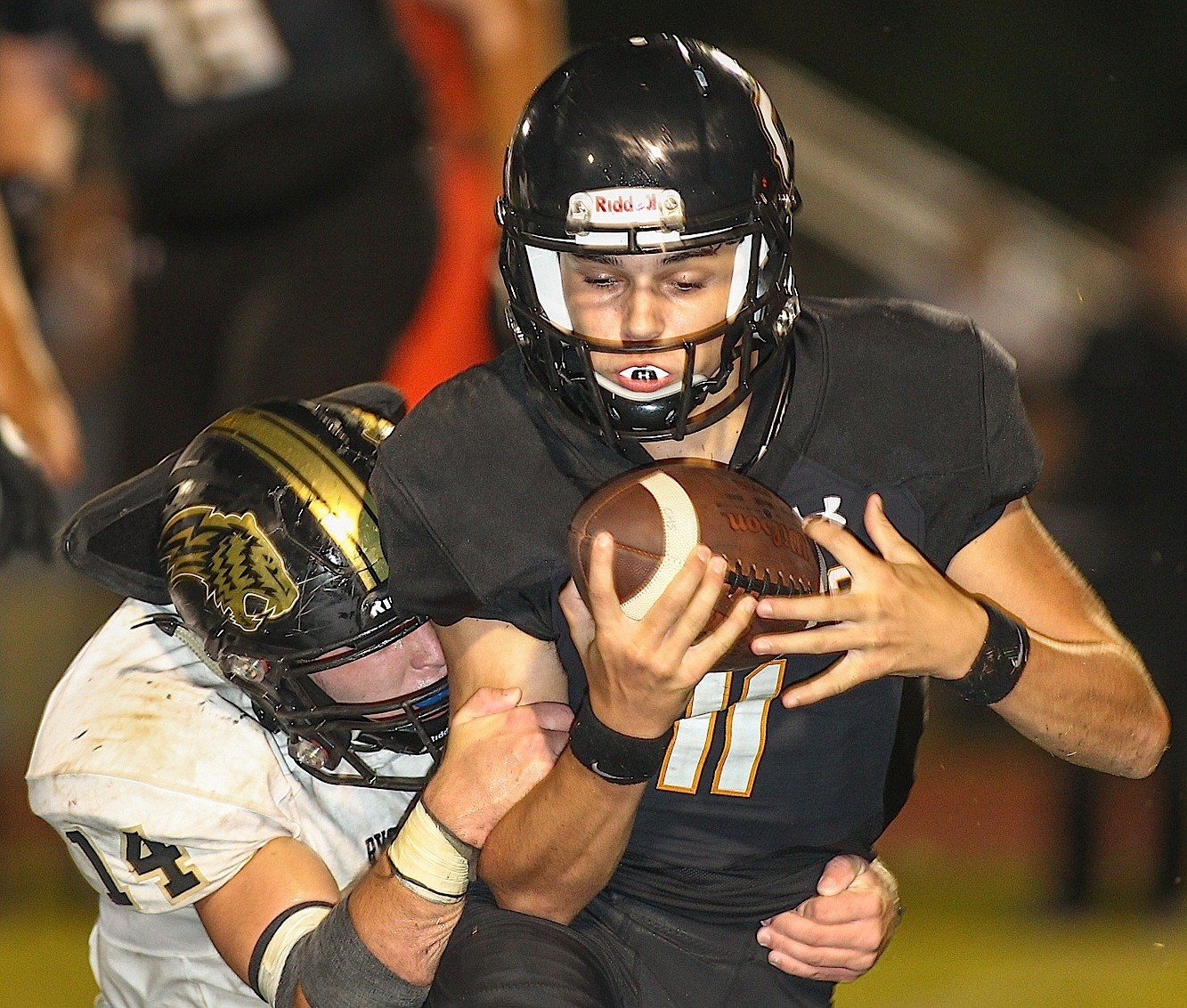 Corner quarterback Andrew Baker (11) is wrapped up by Russellville's Nathan Green (14) during Friday's game. Russellville beat Corner 24-13.