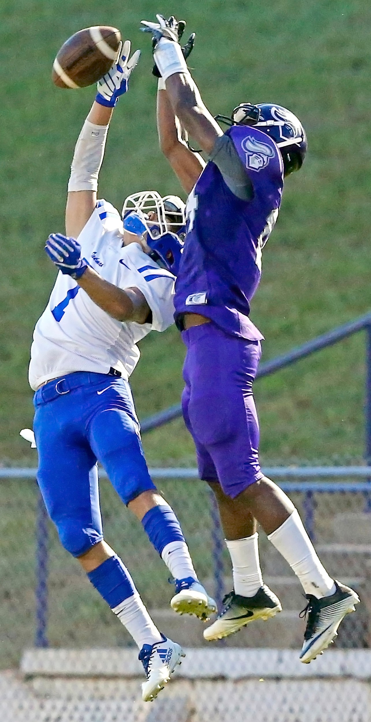 Oakman's Ryan Shepard (1) breaks up a pass intended for a Holt receiver during their game Friday night. Oakman won 27-0.
