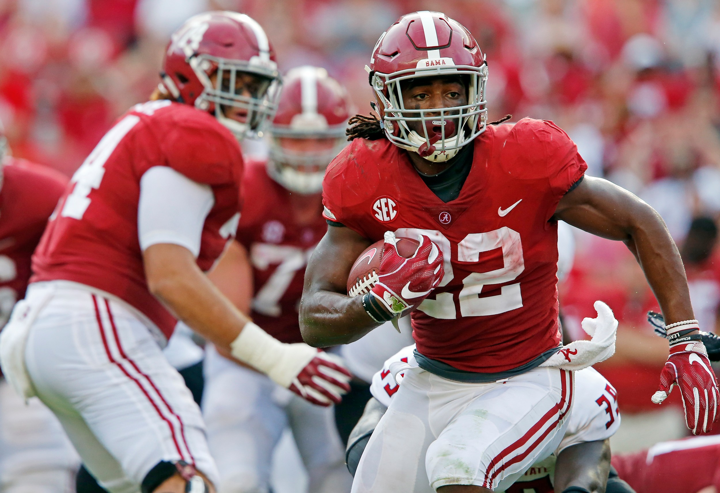 Alabama's Najee Harris (22) finds running room against Arkansas State during their game at Bryant Denny Stadium in Tuscaloosa on Saturday.
