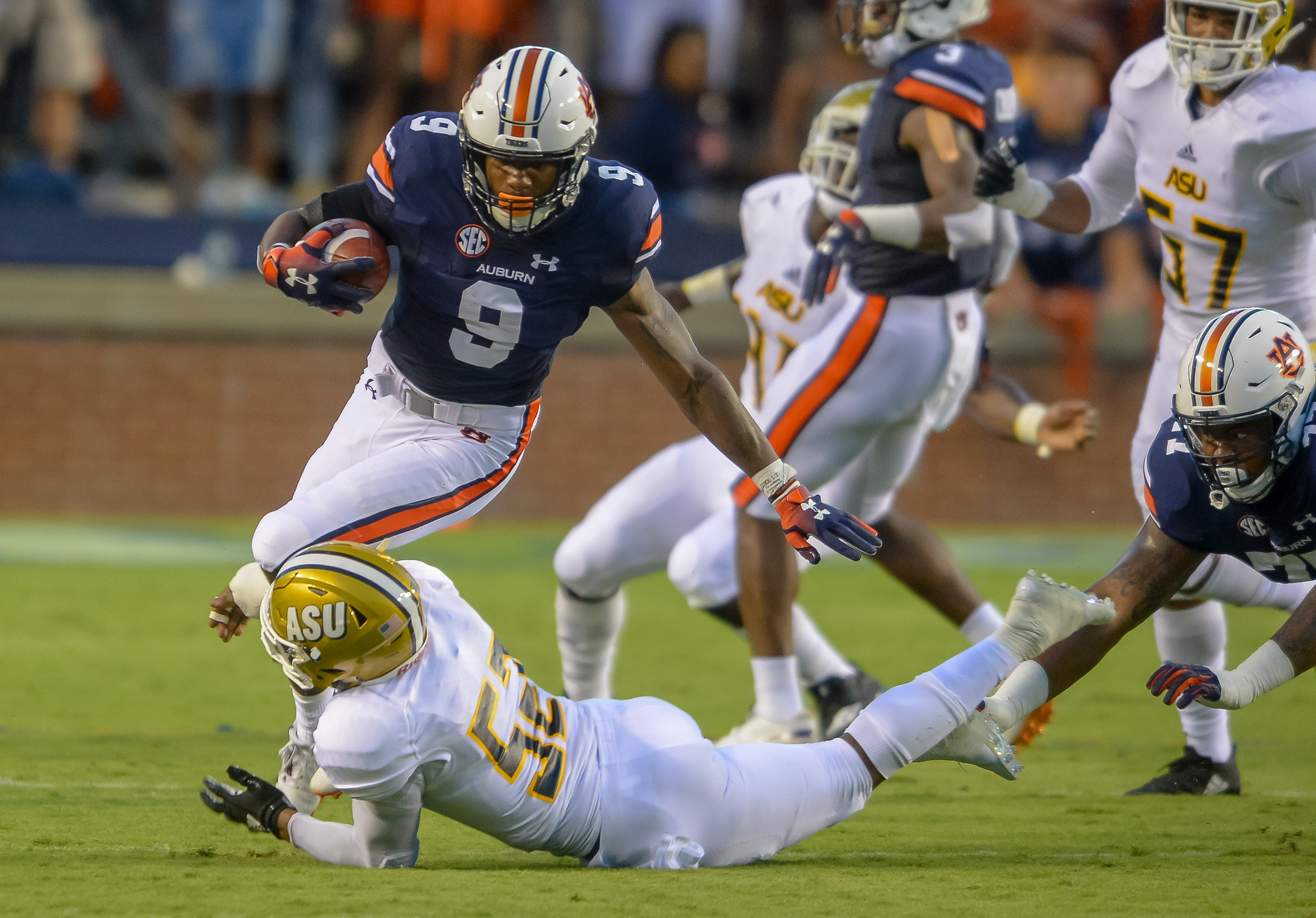 Auburn Tigers running back Kam Martin (9) is tackled by Alabama State Hornets linebacker Malik Bridgers (52) during the first half of Saturday's game, at Jordan Hare Stadium in Auburn, AL. (Contributed by Jeff Johnsey)
