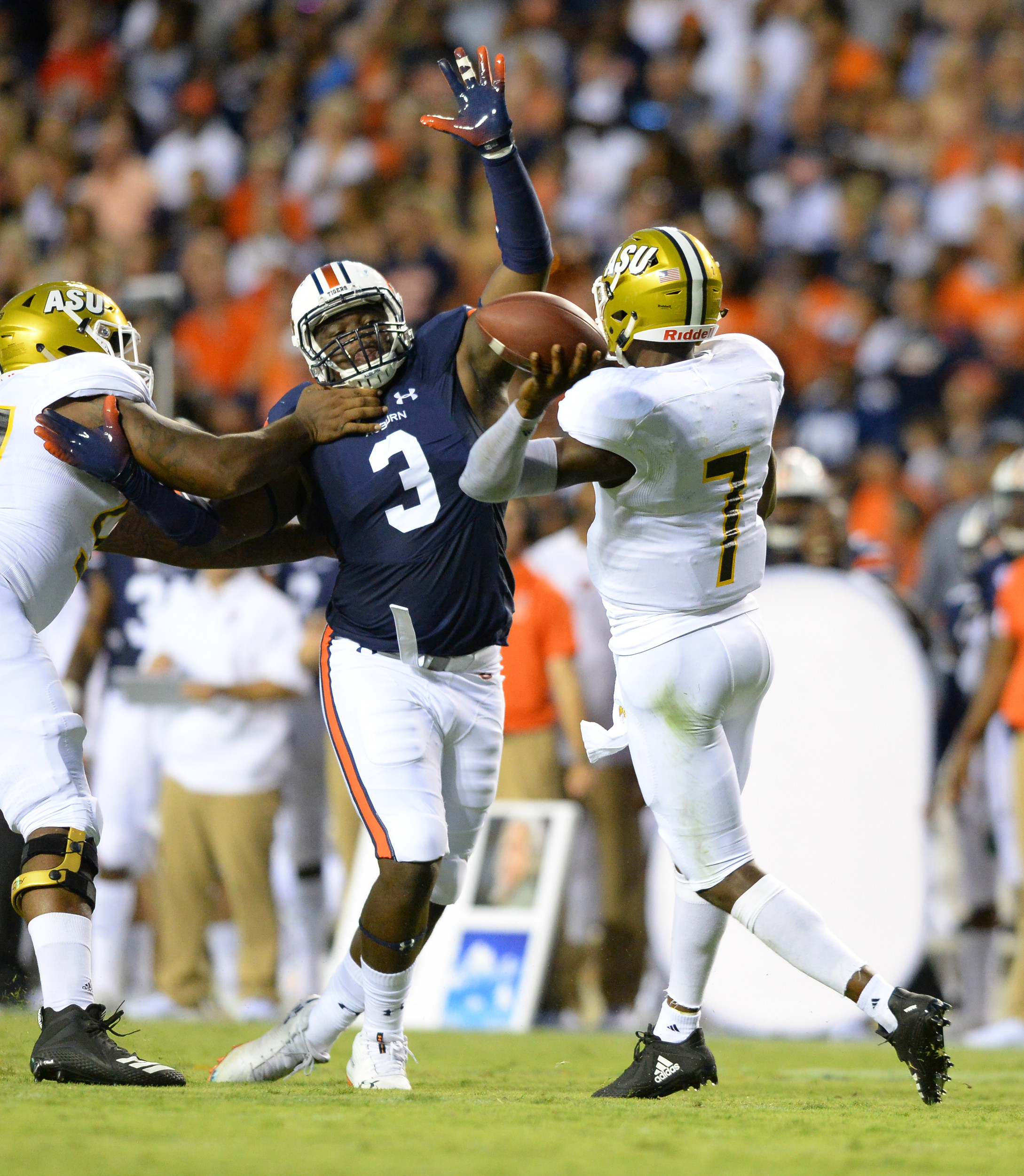 Auburn Tigers defensive lineman Marlon Davidson (3) pressures Alabama State Hornets quarterback Darryl Pearson Jr. (7) during the first half of Saturday's game, at Jordan Hare Stadium in Auburn, AL. (Contributed by Jeff Johnsey)