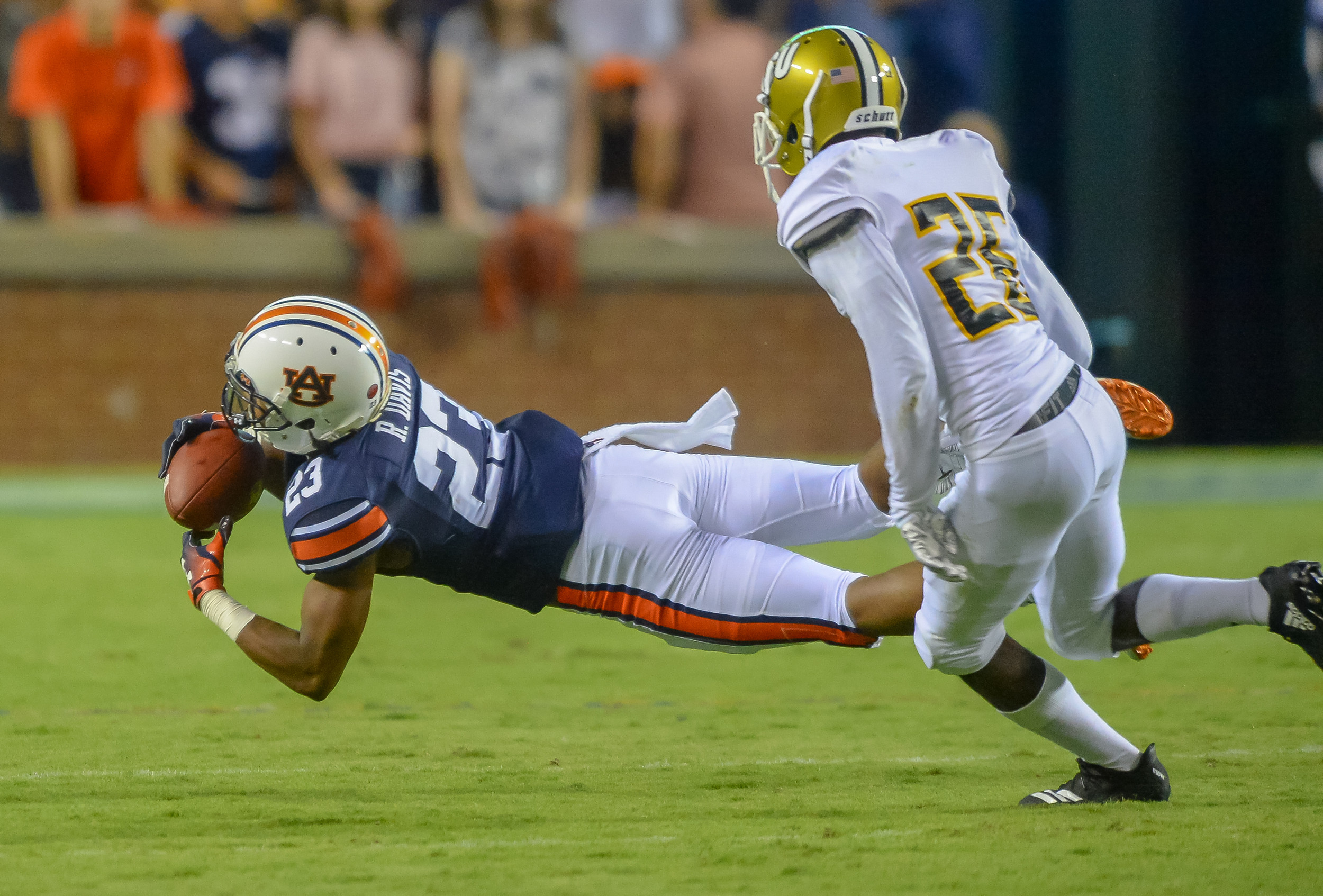 Auburn Tigers wide receiver Ryan Davis (23) make a diving catch in front of Alabama State Hornets defensive back Davian Brantley (29) during the first half of Saturday's game, at Jordan Hare Stadium in Auburn, AL. (Contributed by Jeff Johnsey)