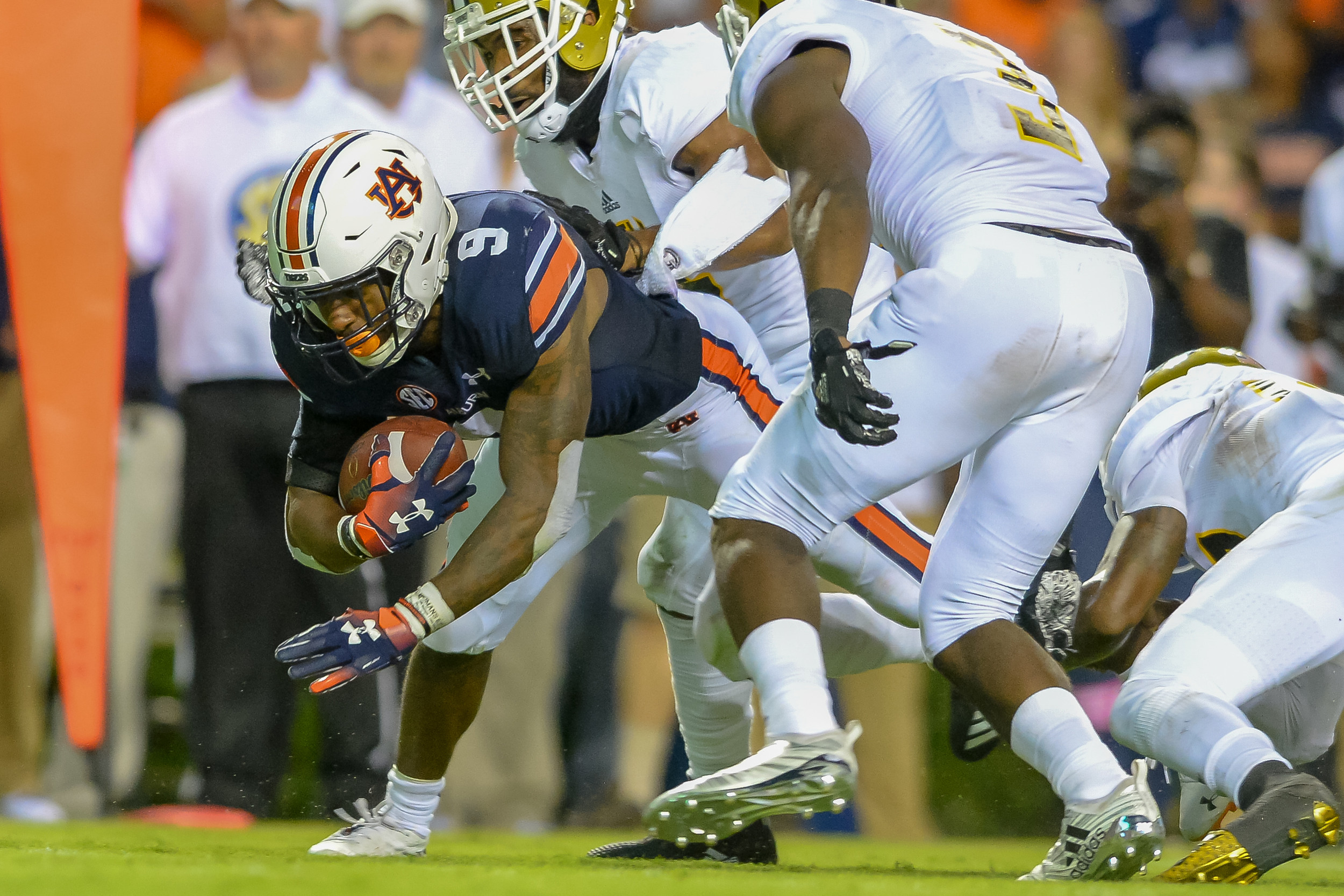 Auburn Tigers running back Kam Martin (9) stretches for yards during the first half of Saturday's game, at Jordan Hare Stadium in Auburn, AL. (Contributed by Jeff Johnsey)