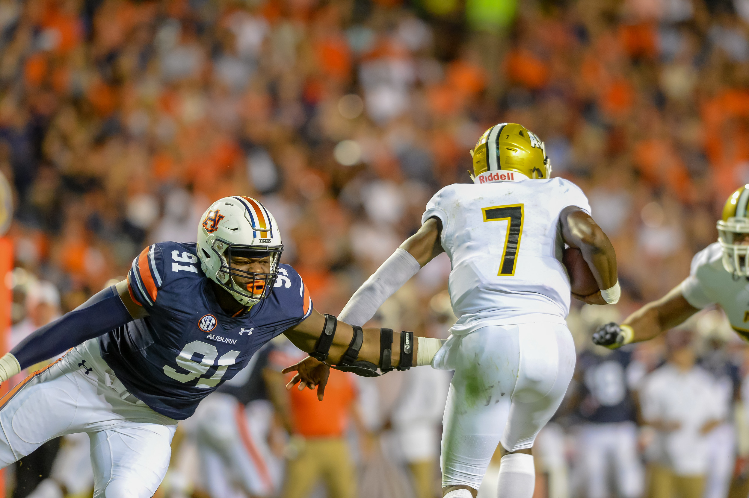 Auburn Tigers defensive lineman Nick Coe (91) pressures Alabama State Hornets quarterback Darryl Pearson Jr. (7) during the first half of Saturday's game, at Jordan Hare Stadium in Auburn, AL. (Contributed by Jeff Johnsey)