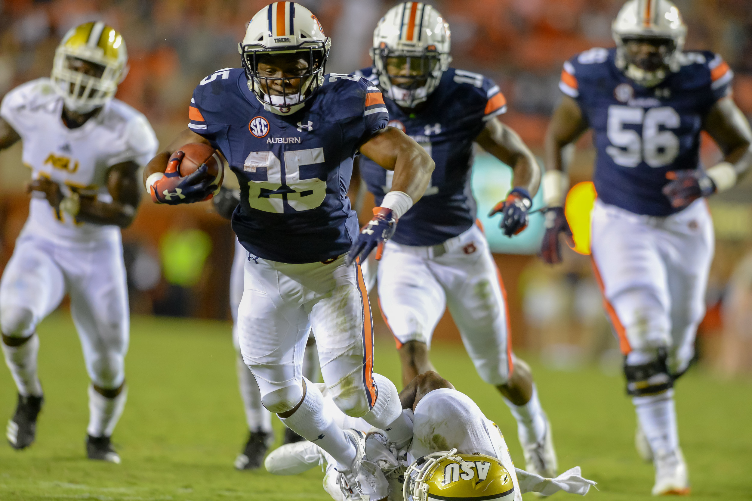 Auburn Tigers running back Shaun Shivers (25) runs during the second half of Saturday's game, at Jordan Hare Stadium in Auburn Atlanta. (Contributed by Jeff Johnsey)