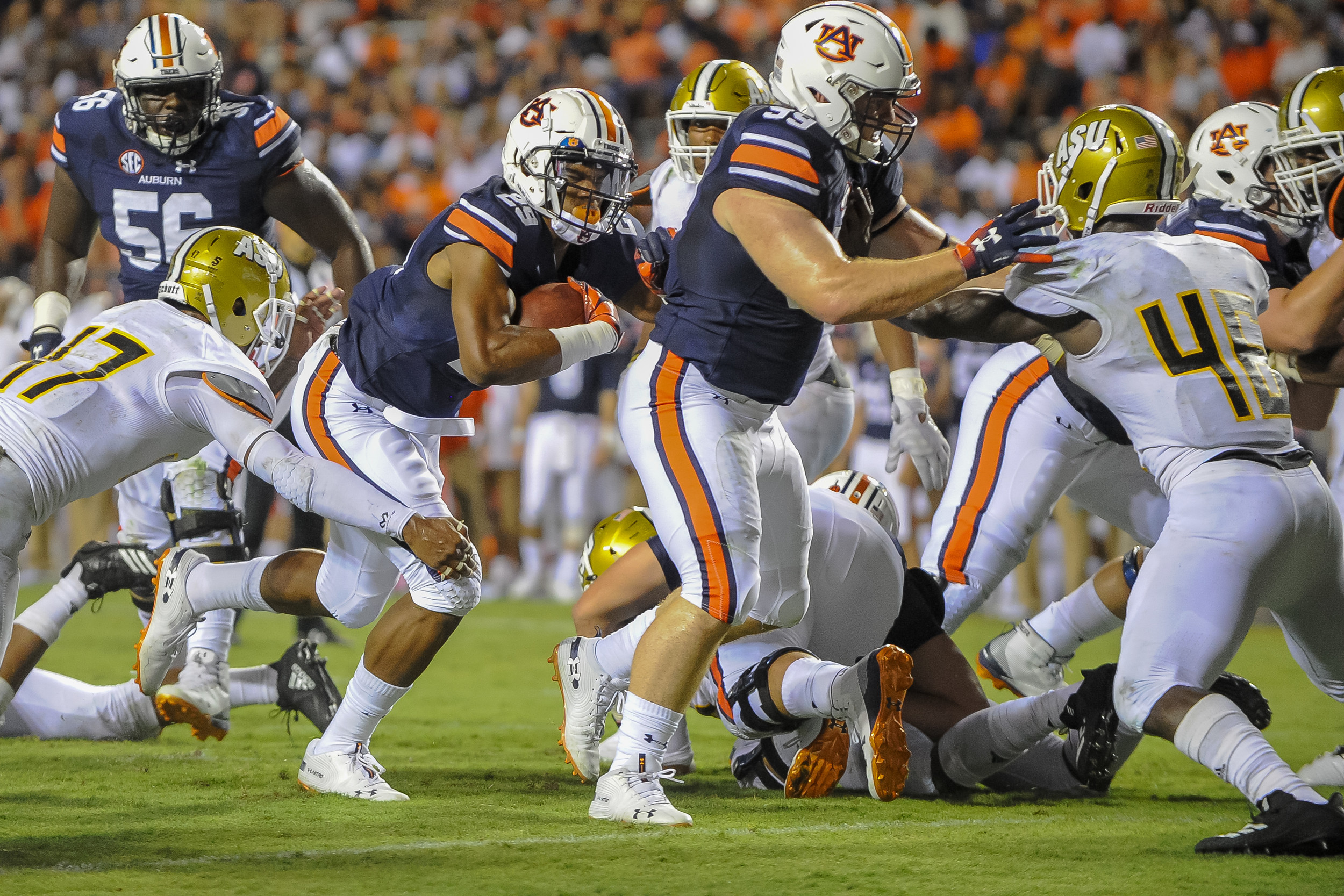 Auburn Tigers running back Harold Joiner (29) scores a touchdown behind the blocking of fullback Spencer Nigh (99) during the second half of Saturday's game, at Jordan Hare Stadium in Auburn Atlanta. (Contributed by Jeff Johnsey)
