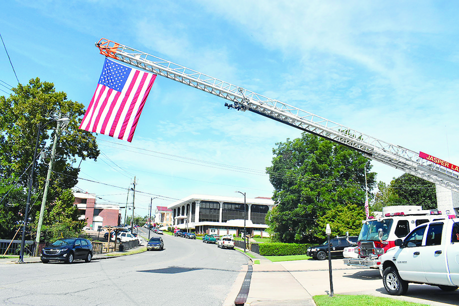 Firefighters hung an American flag on one of its trucks at its downtown fire station to mark the anniversary of the Sept. 11, 2001 terrorist attacks.