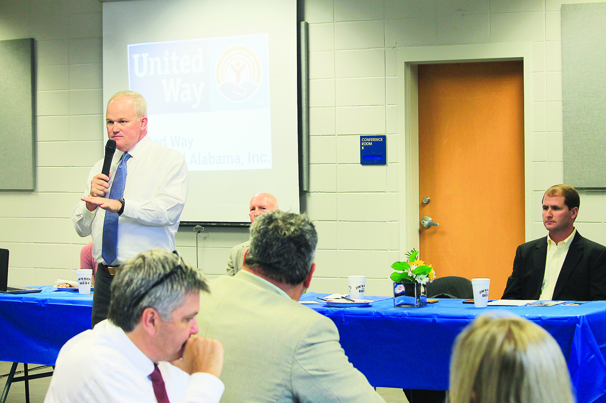 Alan Register, chairman of the 2018 United Way of Central Alabama campaign, speaks at a kickoff luncheon in Jasper on Thursday. Britton Lightsey, seated at right, is serving as Walker County's campaign chairman.