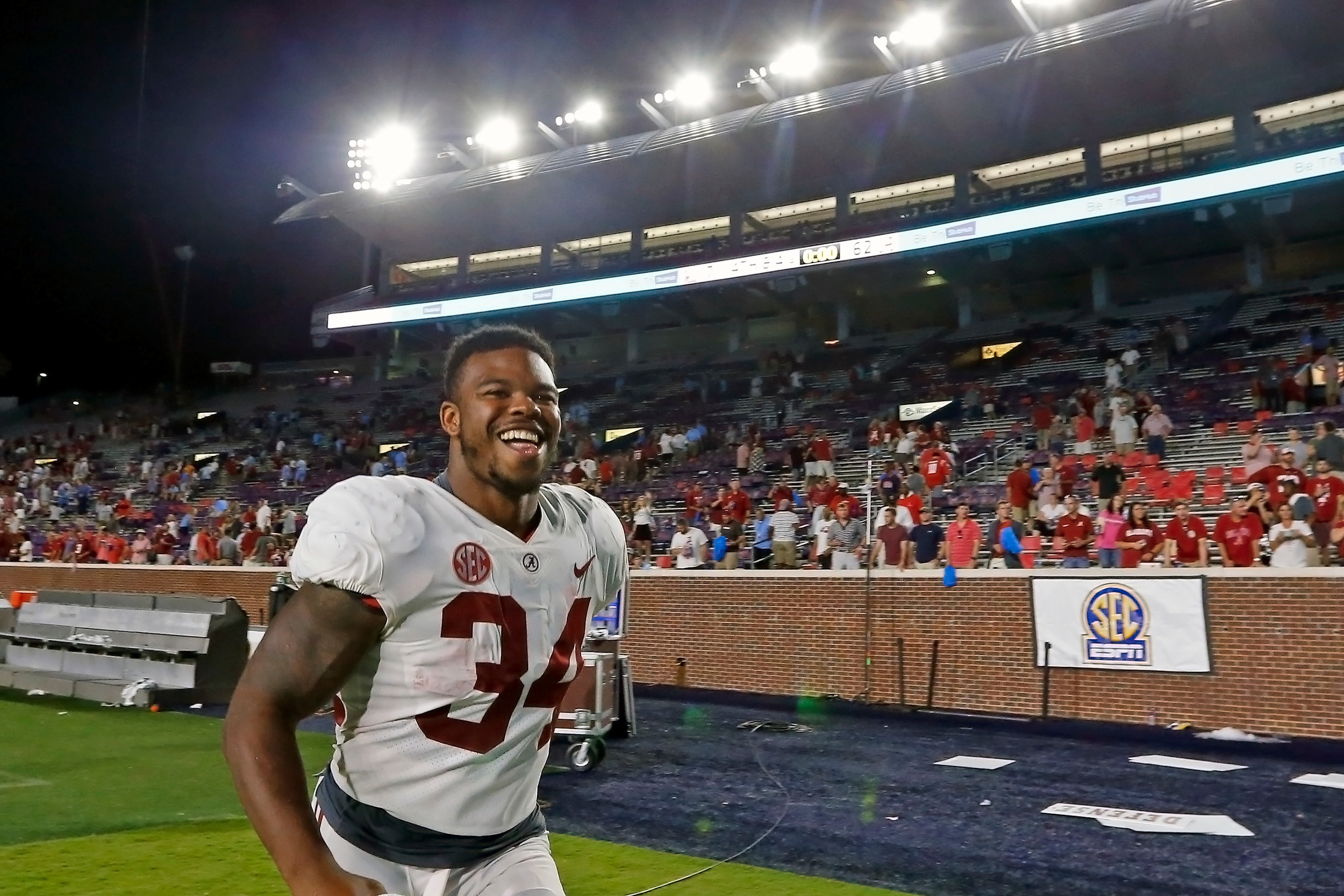 Alabama Crimson Tide running back Damien Harris (34) celebrating after a blowout win against Ole Miss at Vaught-Hemingway Stadium. Jason Clark / Daily Mountain Eagle