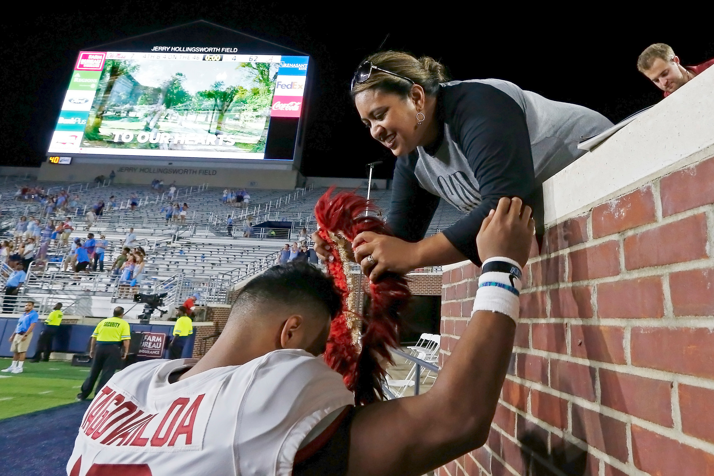 Alabama Crimson Tide quarterback Tua Tagovailoa (13) with his mother after the game between the University of Alabama and Ole Miss at Vaught-Hemingway Stadium. Jason Clark / Daily Mountain Eagle