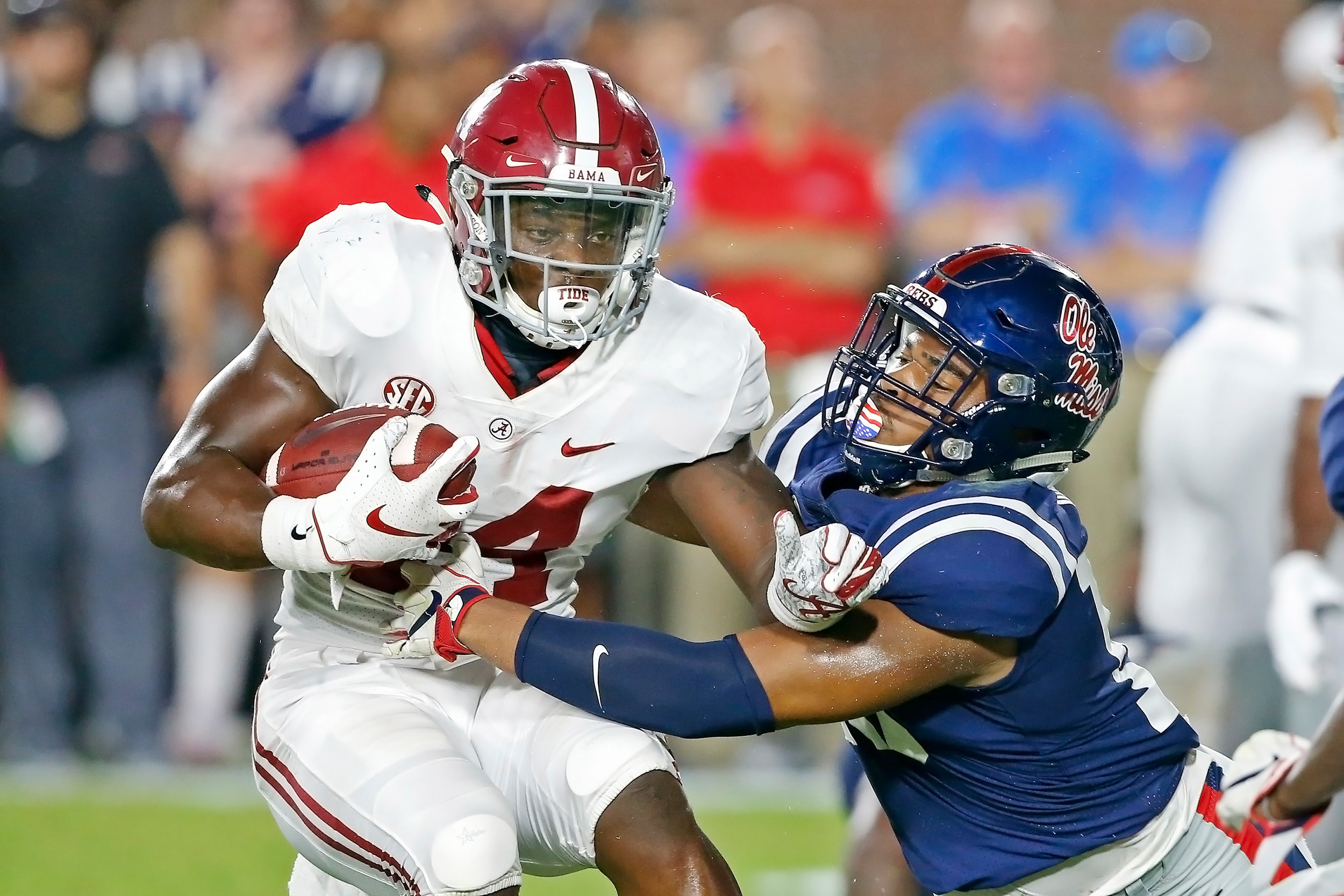 Alabama Crimson Tide running back Brian Robinson Jr. (24) is tackled by Mississippi Rebels linebacker Jacquez Jones (10) during the game between the University of Alabama and Ole Miss at Vaught-Hemingway Stadium. Jason Clark / Daily Mountain Eagle