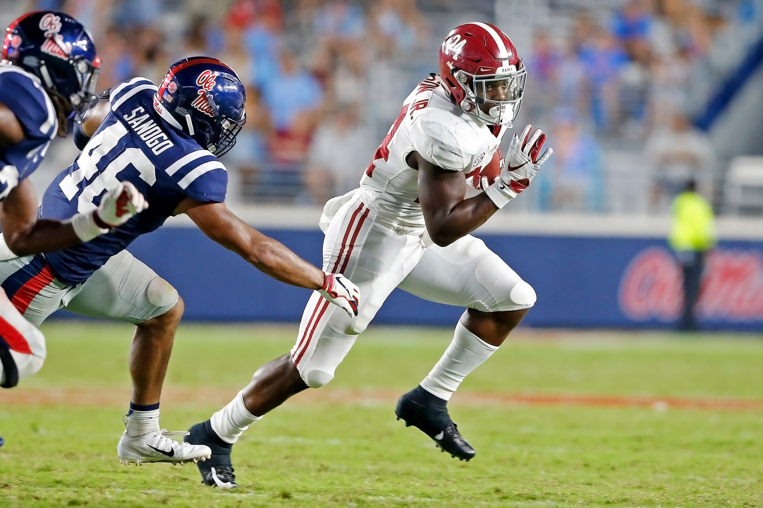 Alabama Crimson Tide running back Brian Robinson Jr. (24) rushes for a first down during the game between the University of Alabama and Ole Miss at Vaught-Hemingway Stadium. Jason Clark / Daily Mountain Eagle