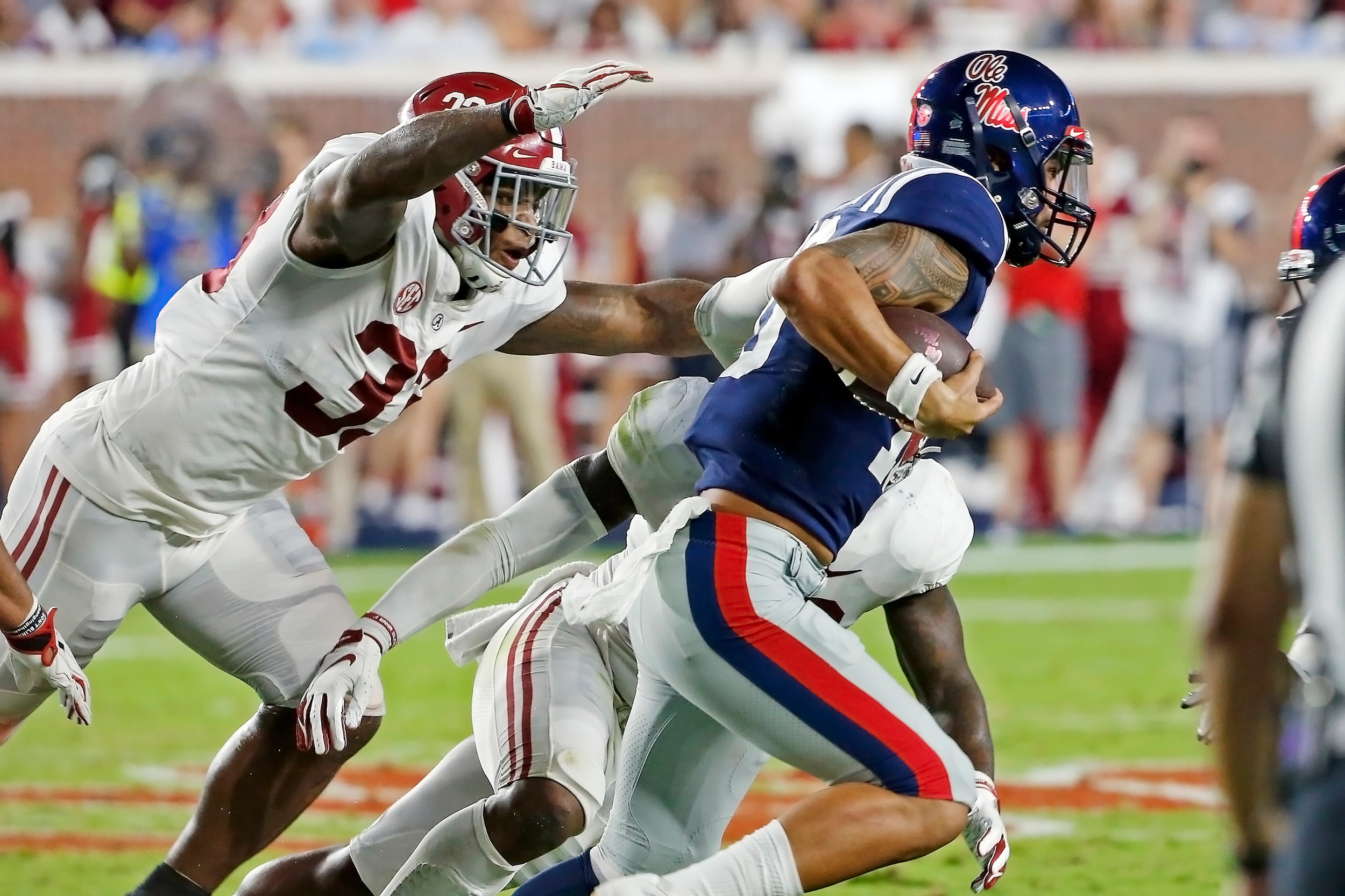 Alabama Crimson Tide linebacker Anfernee Jennings (33) tries to make a tackle during the game between the University of Alabama and Ole Miss at Vaught-Hemingway Stadium. Jason Clark / Daily Mountain Eagle