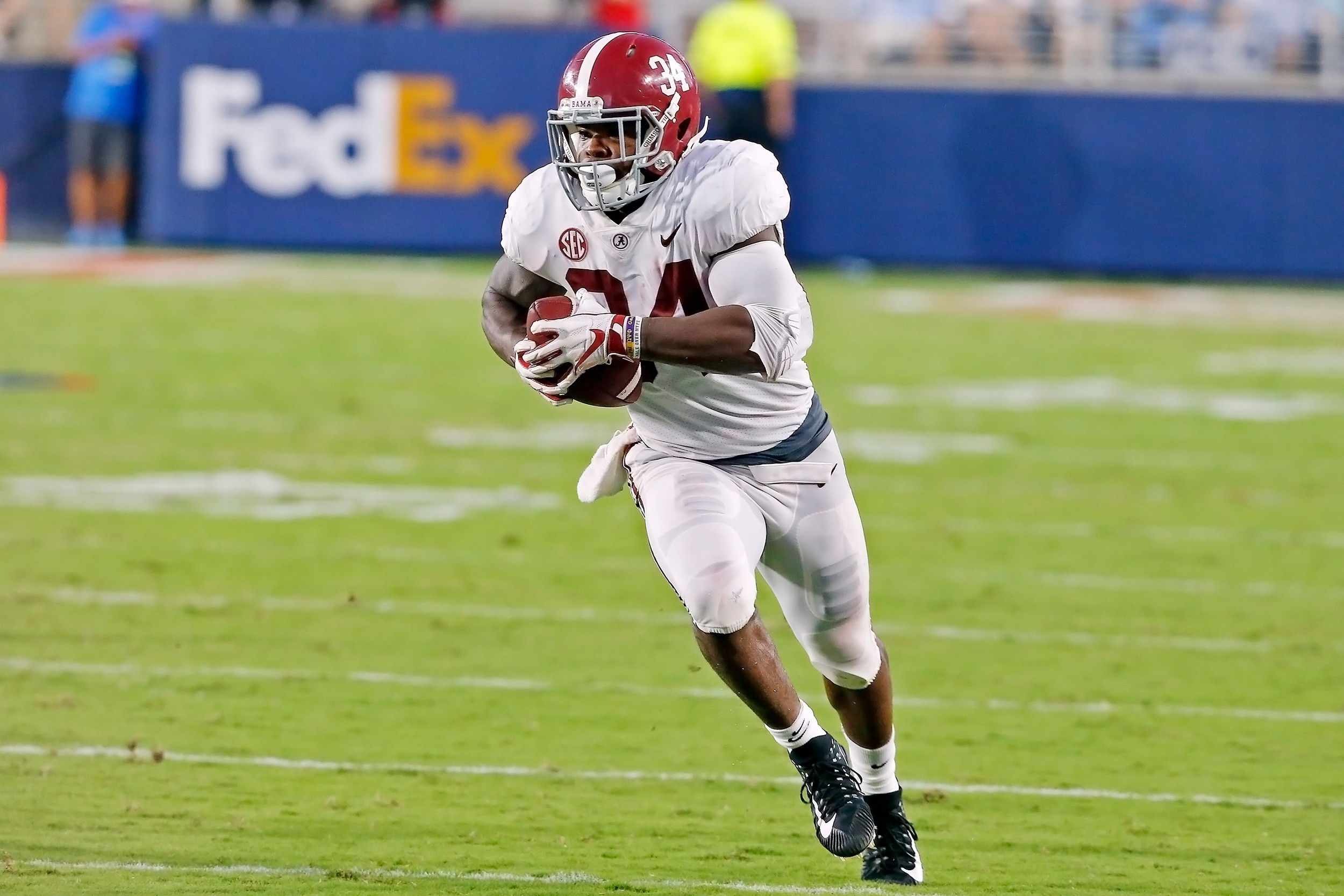 Alabama Crimson Tide running back Damien Harris (34) rushes for a first down during the game between the University of Alabama and Ole Miss at Vaught-Hemingway Stadium. Jason Clark / Daily Mountain Eagle