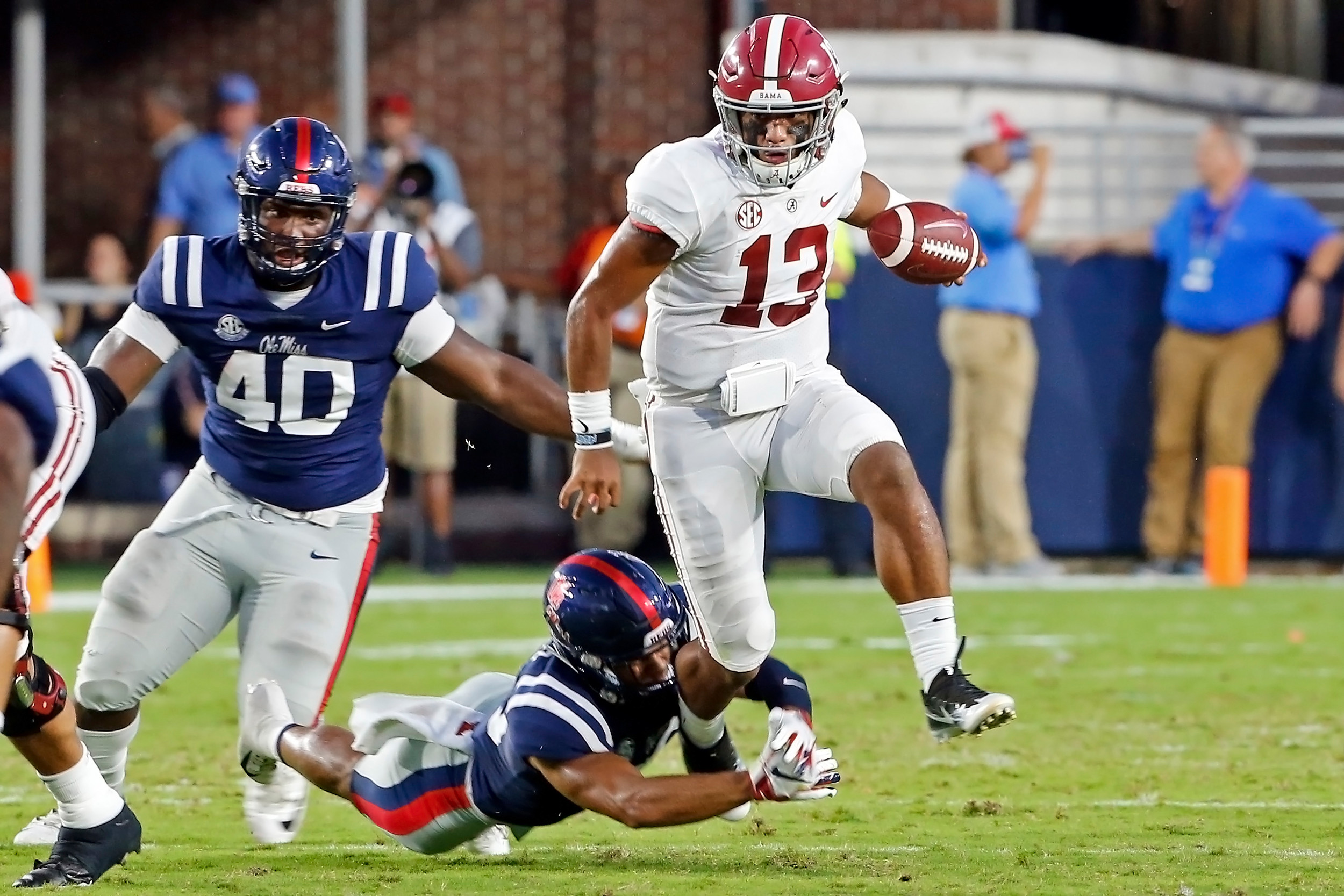 Alabama Crimson Tide quarterback Tua Tagovailoa (13) rushes for a first down during the game between the University of Alabama and Ole Miss at Vaught-Hemingway Stadium. Jason Clark / Daily Mountain Eagle