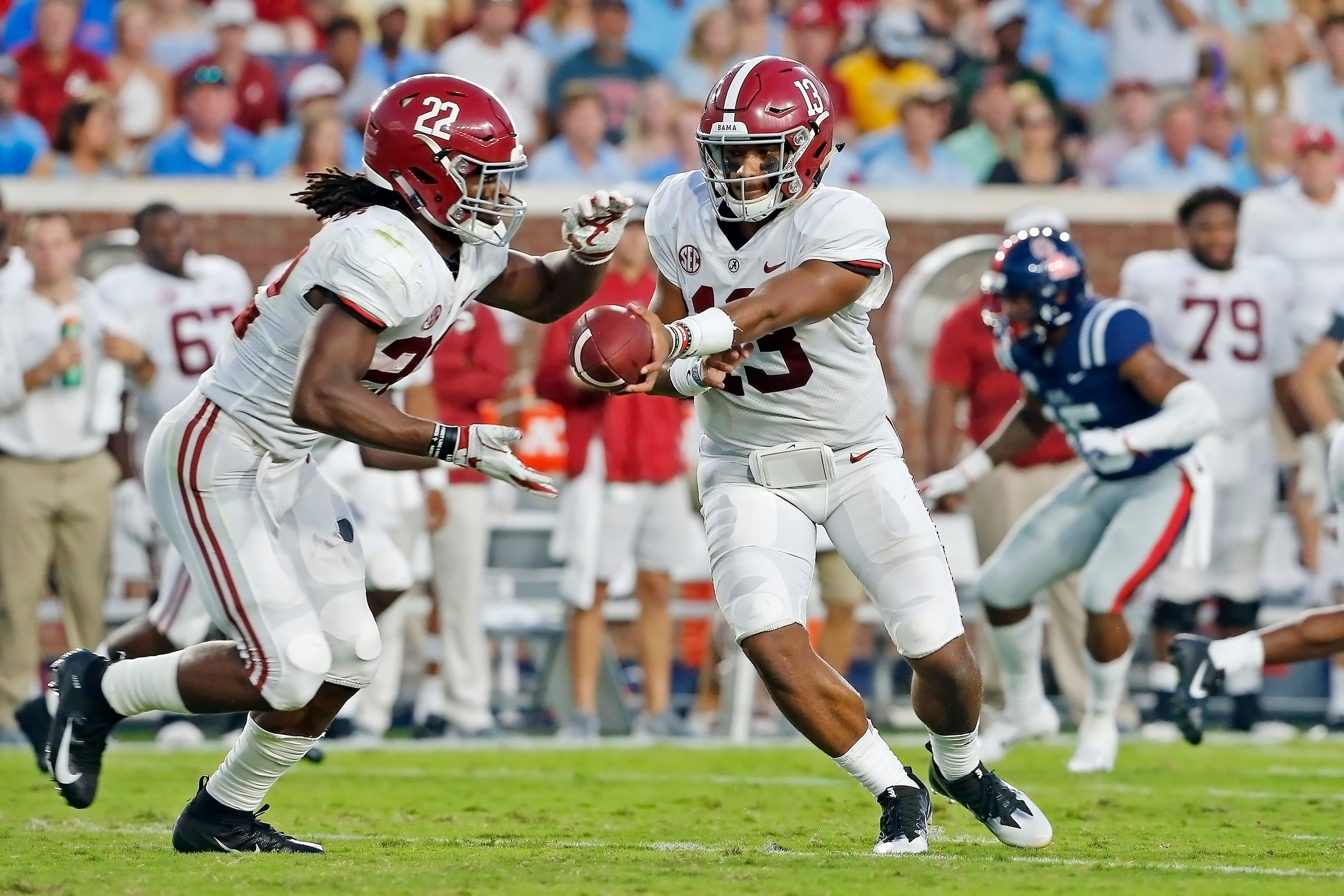Alabama Crimson Tide quarterback Tua Tagovailoa (13) hands off to running back Najee Harris (22)during the game between the University of Alabama and Ole Miss at Vaught-Hemingway Stadium. Jason Clark / Daily Mountain Eagle