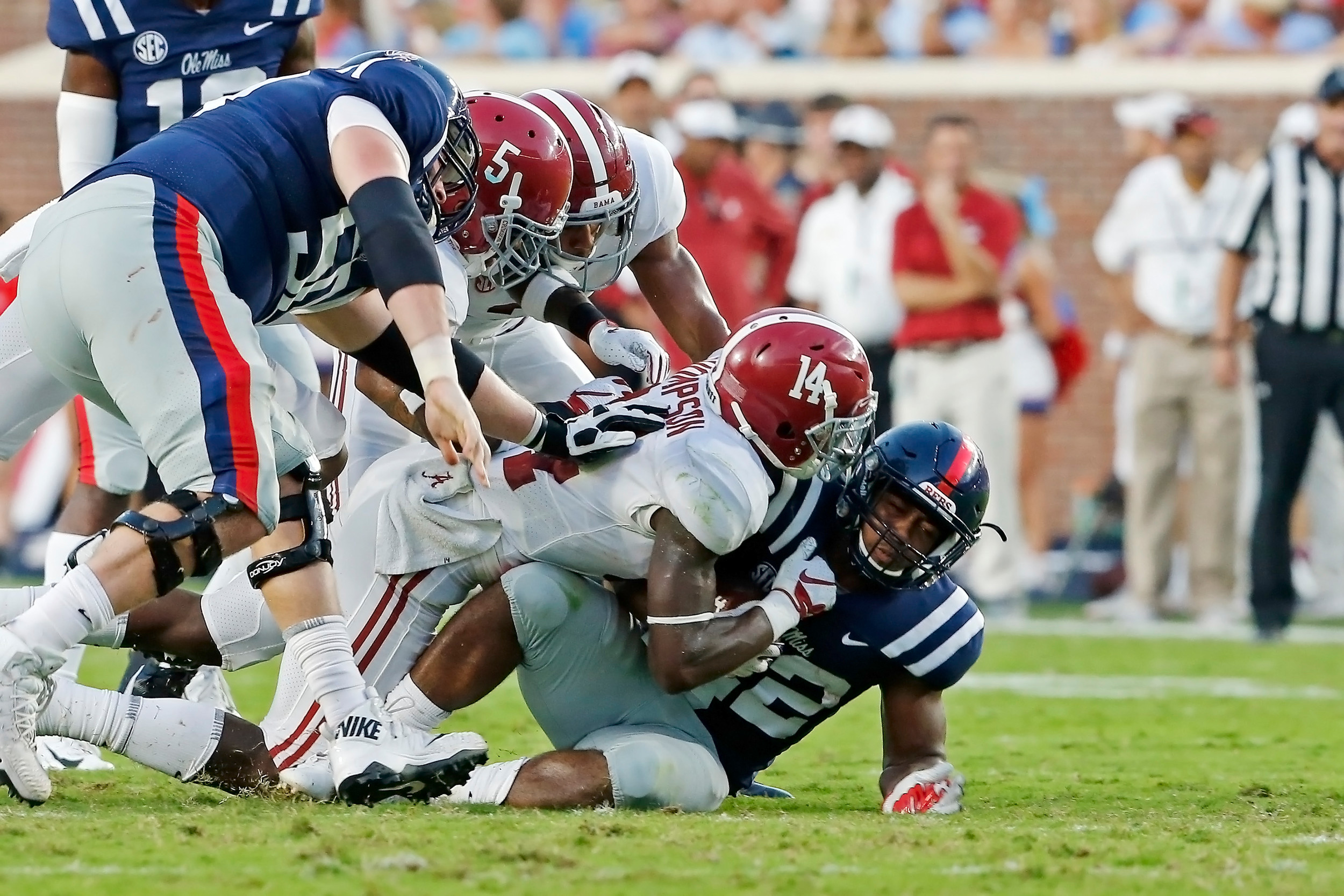 Alabama Crimson Tide defensive back Deionte Thompson (14) tackles Mississippi Rebels running back Scottie Phillips (22) during the game between the University of Alabama and Ole Miss at Vaught-Hemingway Stadium. Jason Clark / Daily Mountain Eagle