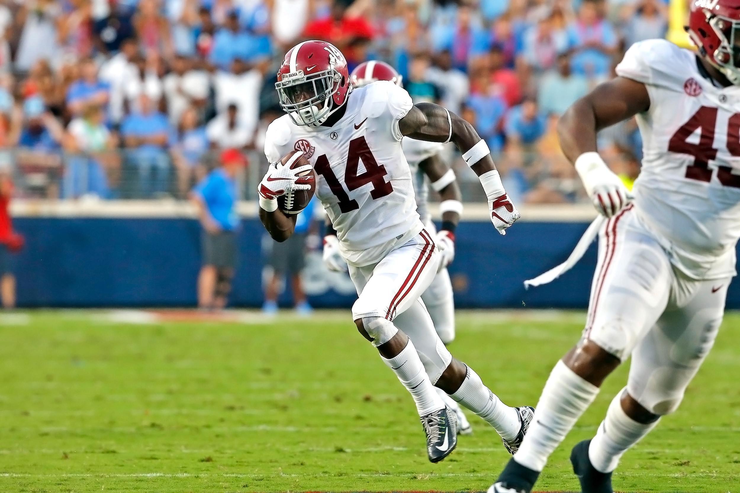 Alabama Crimson Tide defensive back Deionte Thompson (14) returns the ball after an interception during the game between the University of Alabama and Ole Miss at Vaught-Hemingway Stadium. Jason Clark / Daily Mountain Eagle
