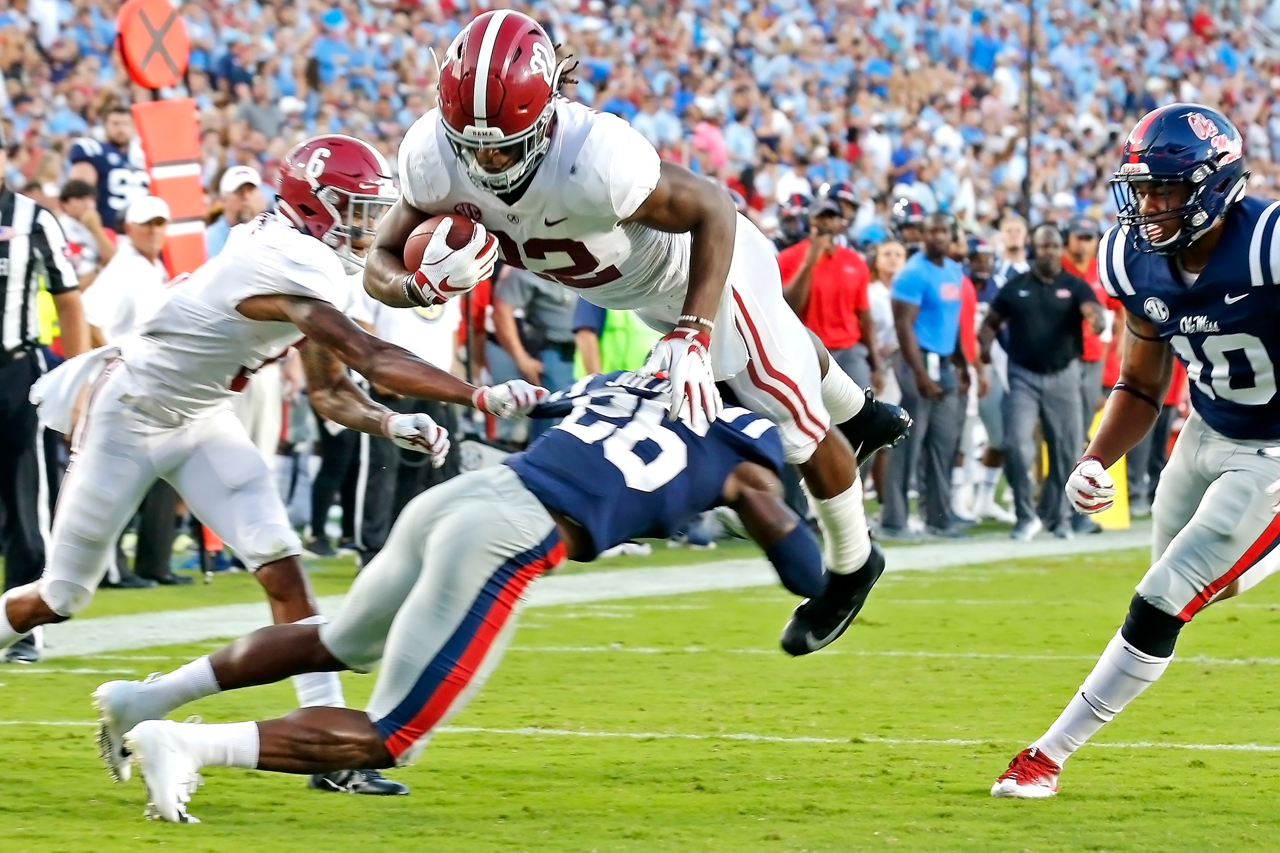 Alabama Crimson Tide running back Najee Harris (22) leaps for a touchdown during the game between the University of Alabama and Ole Miss at Vaught-Hemingway Stadium. Jason Clark / Daily Mountain Eagle