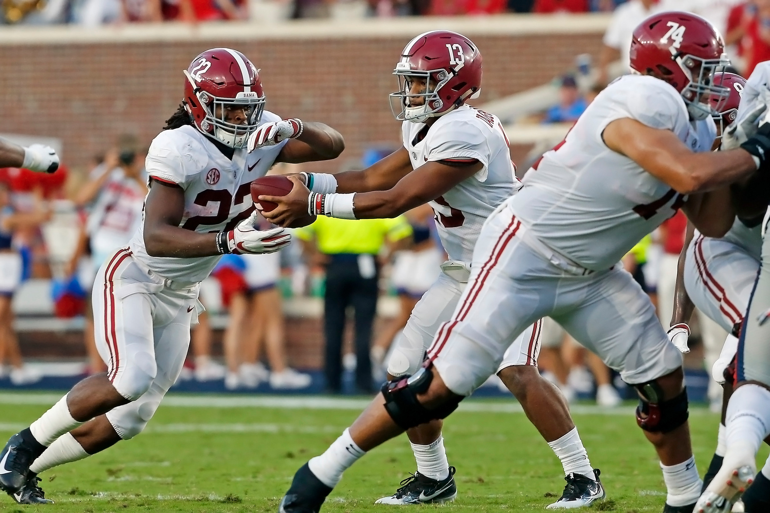 Alabama Crimson Tide quarterback Tua Tagovailoa (13) hands off to running back Najee Harris (22) during the game between the University of Alabama and Ole Miss at Vaught-Hemingway Stadium. Jason Clark / Daily Mountain Eagle