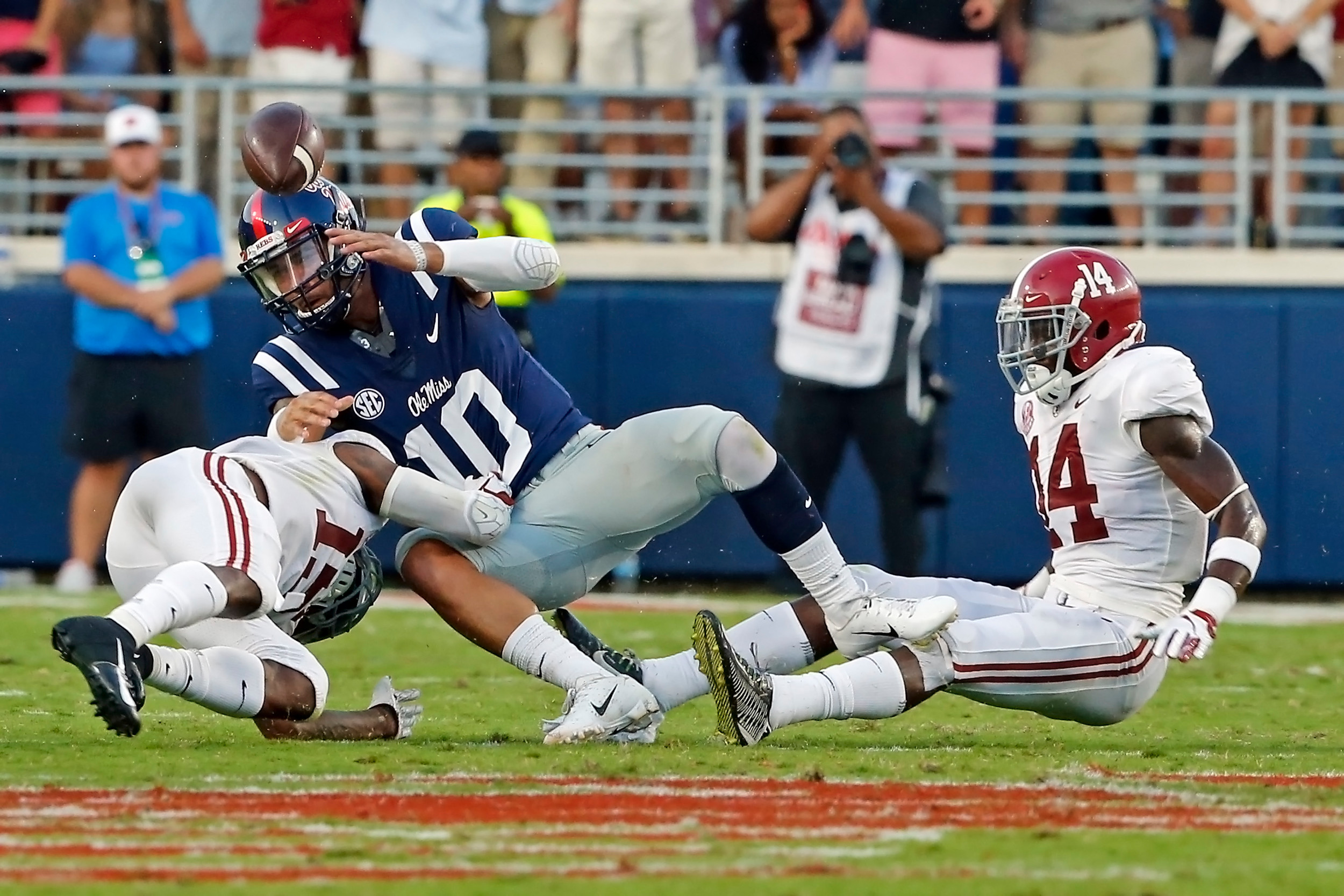 Mississippi Rebels quarterback Jordan Ta'amu (10) coughs up the ball after being hit hard by Alabama Crimson Tide defensive back Xavier McKinney (15) during the game between the University of Alabama and Ole Miss at Vaught-Hemingway Stadium. Jason Clark / Daily Mountain Eagle