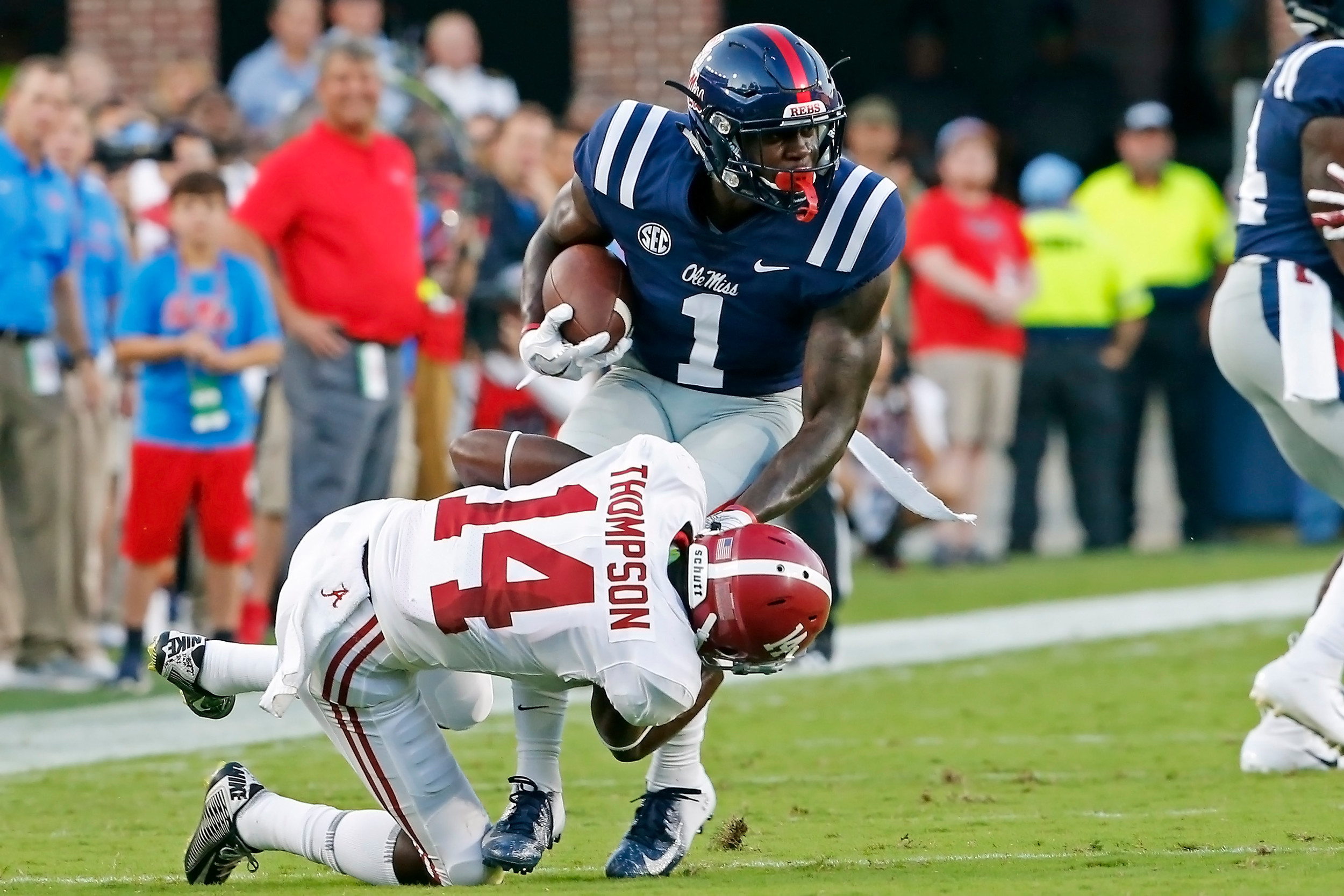 Alabama Crimson Tide defensive back Deionte Thompson (14) tackles Mississippi Rebels wide receiver A.J. Brown (1) during the game between the University of Alabama and Ole Miss at Vaught-Hemingway Stadium. Jason Clark / Daily Mountain Eagle