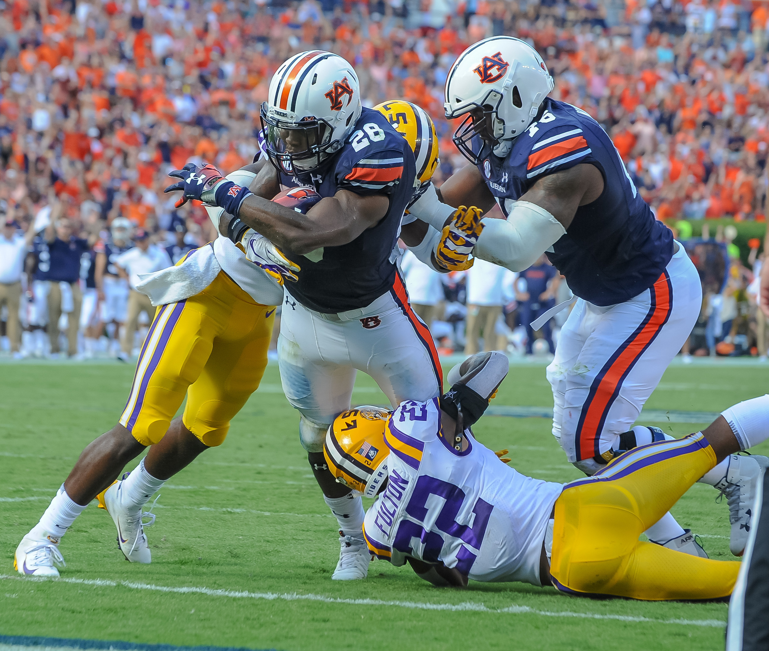Auburn Tigers running back JaTarvious Whitlow (28) scores a touchdown over LSU Tigers cornerback Kristian Fulton (22) during the first half of Saturday's game, at Jordan Hare Stadium in Auburn. (Contributed by Jeff Johnsey)