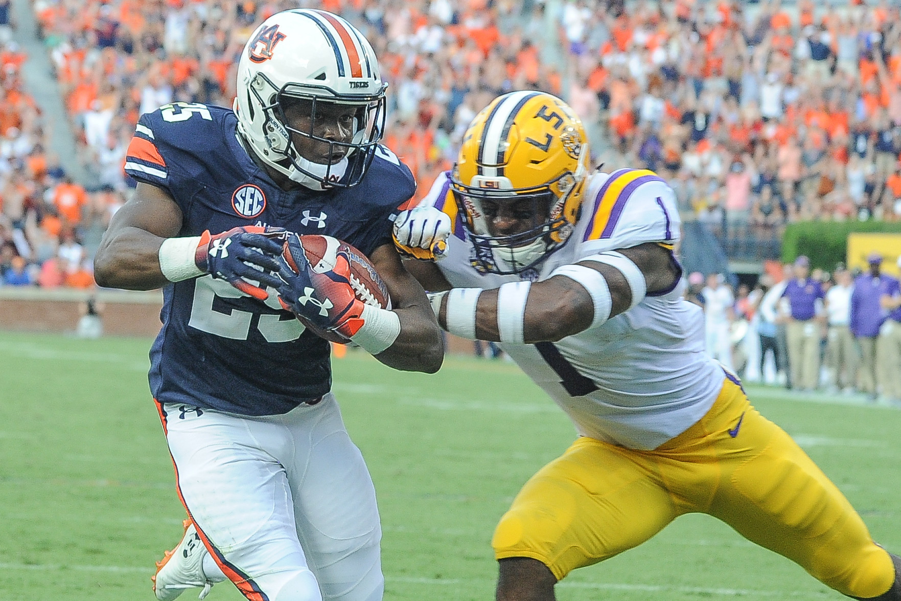 Auburn Tigers running back Shaun Shivers (25) scores in front of LSU Tigers cornerback Kelvin Joseph (1) during the first half of Saturday's game, at Jordan Hare Stadium in Auburn. (Contributed by Jeff Johnsey)
