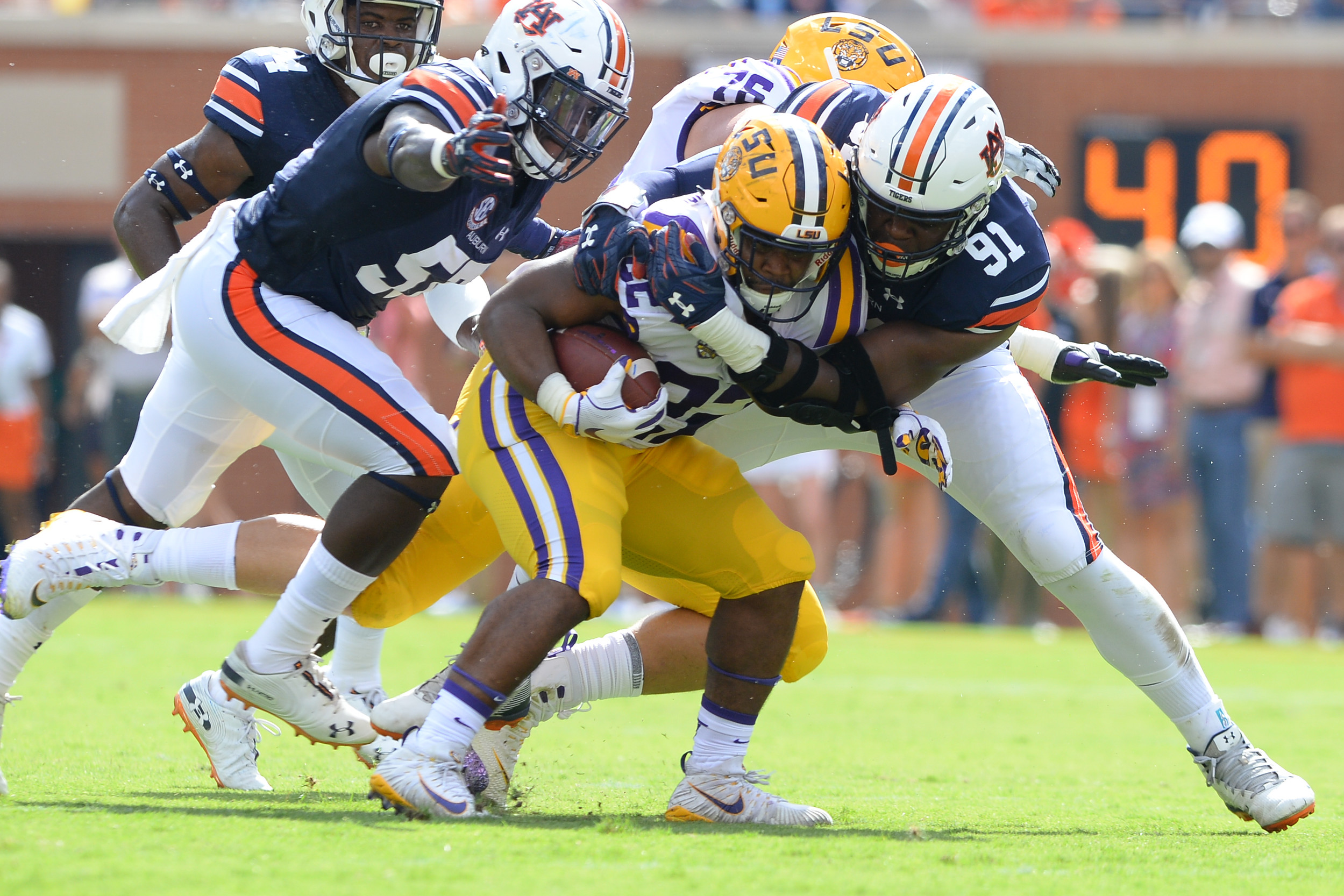 LSU Tigers running back Clyde Edwards-Helaire (22) is tackled for a loss by Auburn Tigers defensive lineman Nick Coe (91) during the first half of Saturday's game, at Jordan Hare Stadium in Auburn. (Contributed by Jeff Johnsey)