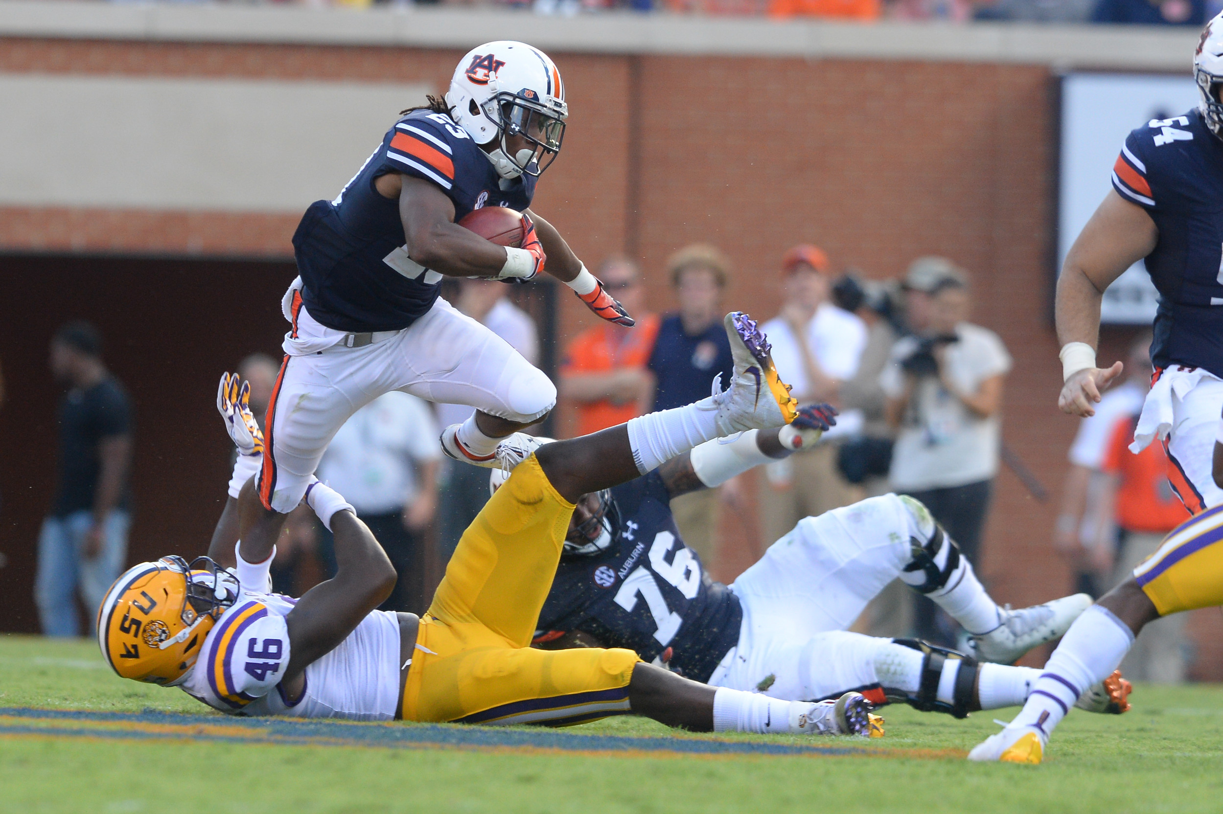 Auburn Tigers wide receiver Ryan Davis (23) breaks the tackle of LSU Tigers linebacker Andre Anthony (46) during the second during the first half of Saturday's game, at Jordan Hare Stadium in Auburn. (Contributed by Jeff Johnsey)