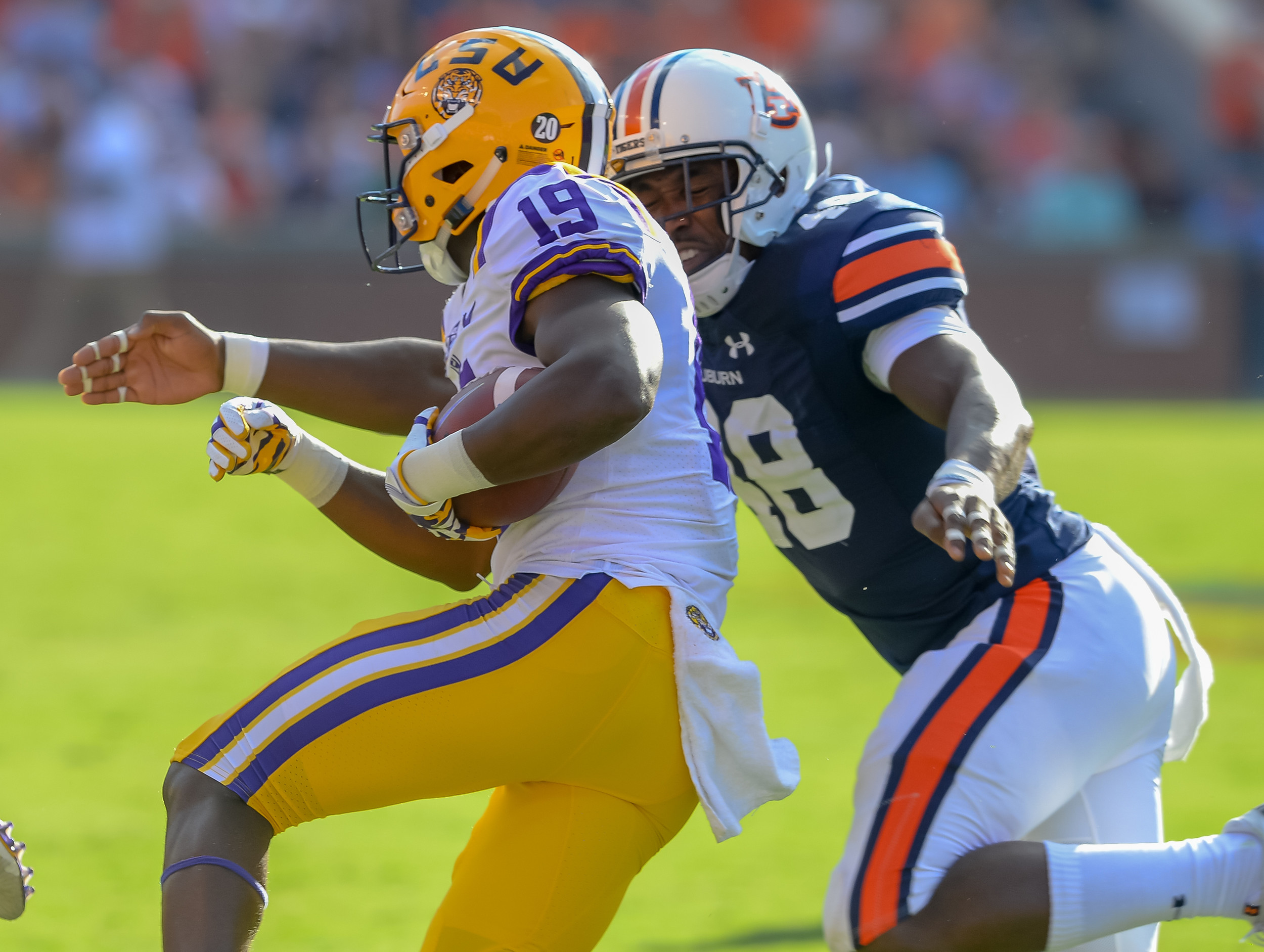 LSU Tigers wide receiver Derrick Dillon (19) is brought down by Auburn Tigers linebacker Montavious Atkinson (48) during the second half of Saturday's game, at Jordan Hare Stadium in Auburn. (Contributed by Jeff Johnsey)