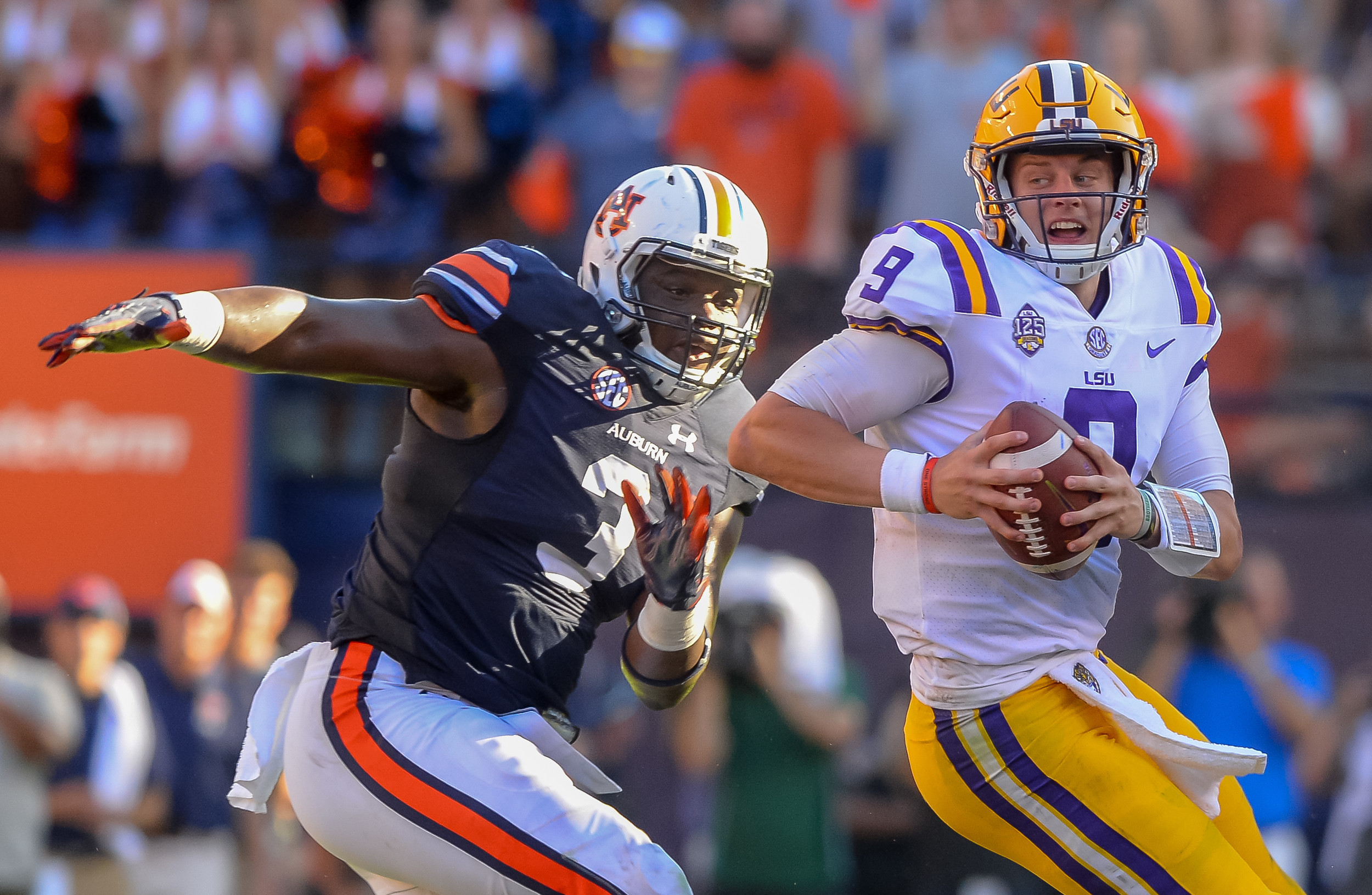 Auburn Tigers defensive lineman Marlon Davidson (3) pressures LSU Tigers quarterback Joe Burrow (9) during the second half of Saturday's game, at Jordan Hare Stadium in Auburn. (Contributed by Jeff Johnsey)