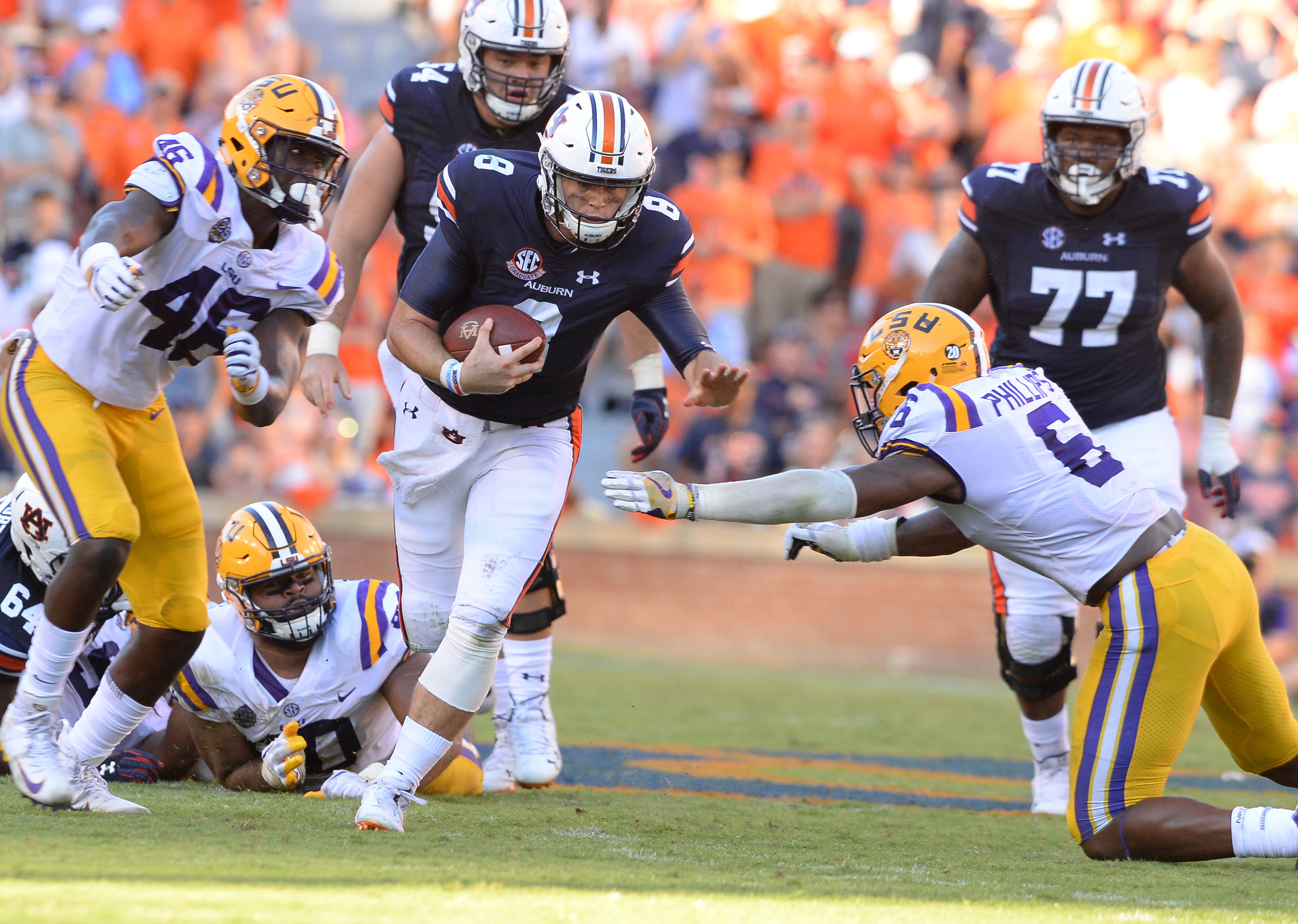 LSU Tigers linebackers Andre Anthony (46) and Jacob Phillips (6) close in on Auburn Tigers quarterback Jarrett Stidham (8) during the second half of Saturday's game, at Jordan Hare Stadium in Auburn. (Contributed by Jeff Johnsey)