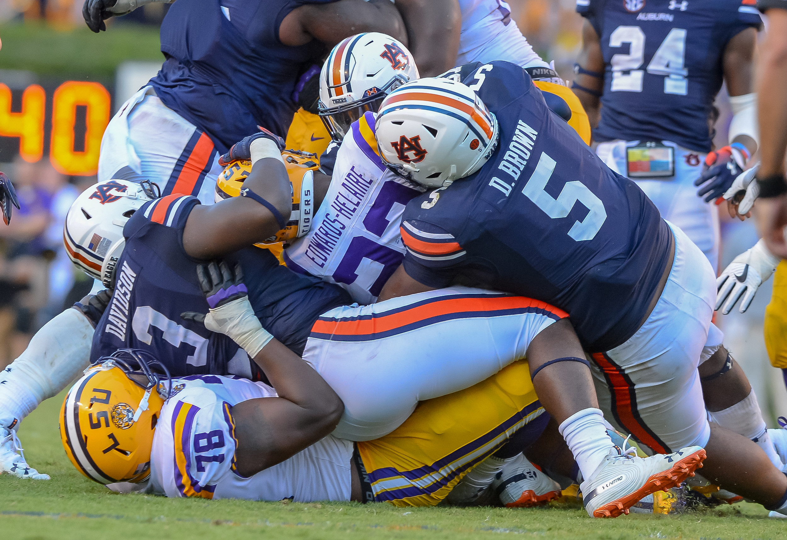LSU Tigers running back Clyde Edwards-Helaire (22) is tackled by Auburn Tigers defensive linemen Marlon Davidson (3) and Derrick Brown (5) during the second half of Saturday's game, at Jordan Hare Stadium in Auburn Atlanta. (Contributed by Jeff Johnsey)