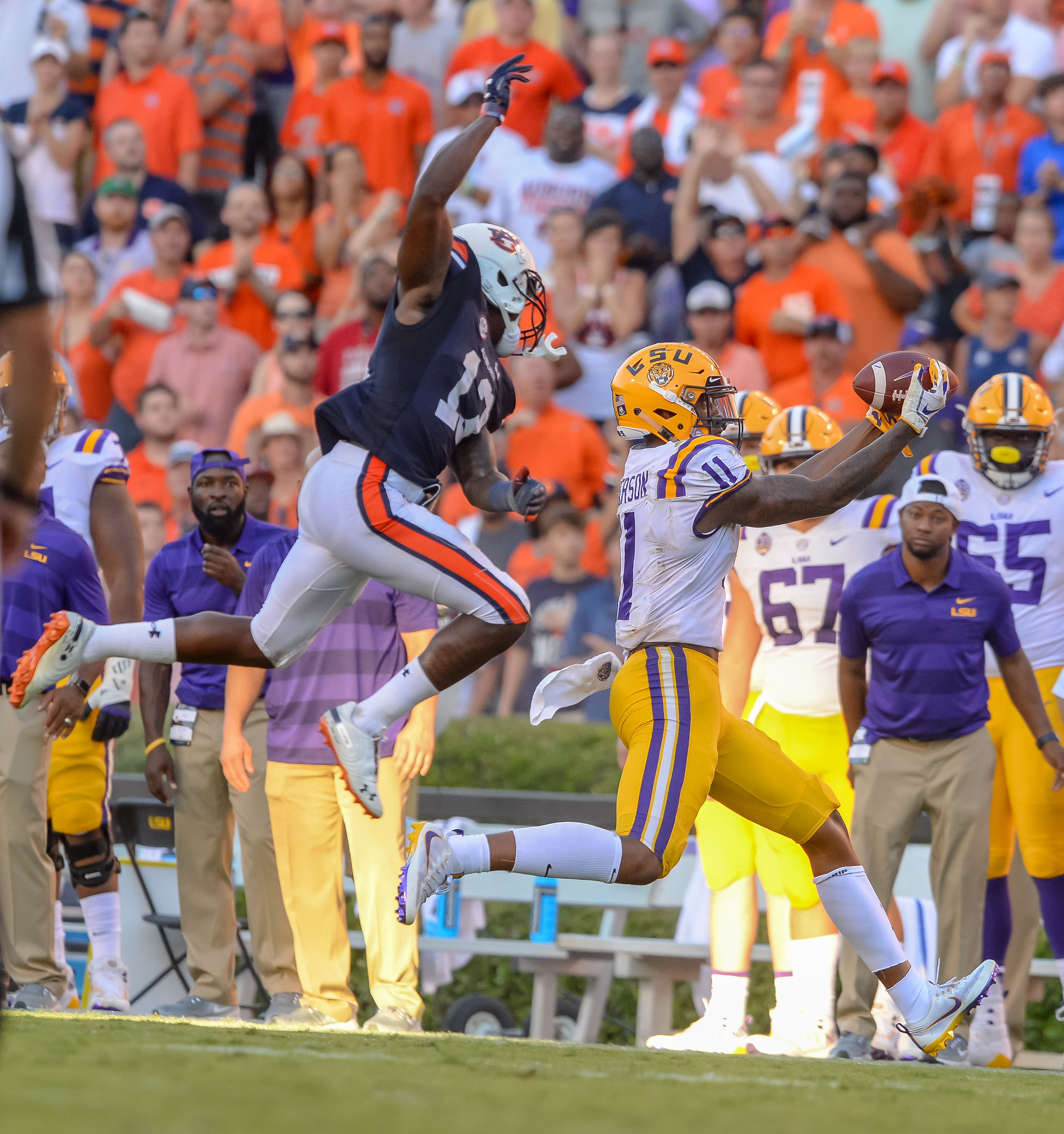 LSU Tigers wide receiver Dee Anderson (11) catches a pass over the outstretched arms of Auburn Tigers defensive back Jamel Dean (12) during the second half of Saturday's game, at Jordan Hare Stadium in Auburn Atlanta. (Contributed by Jeff Johnsey)