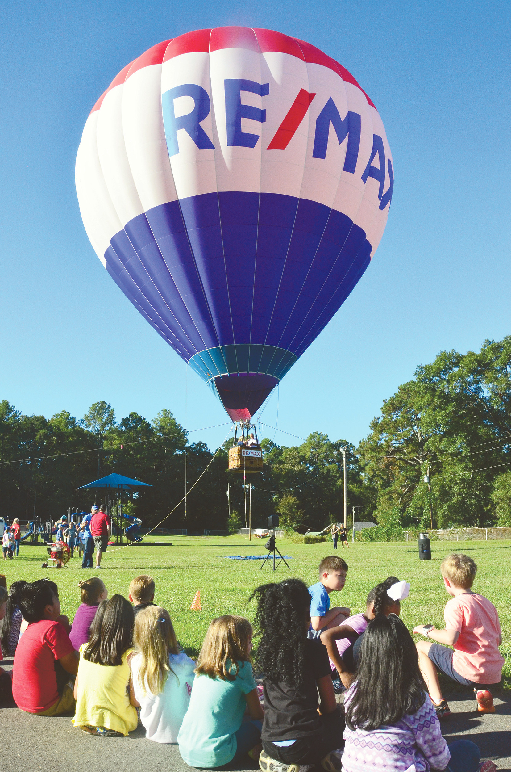A hot air balloon sponsored by Re/Max surprised students at T.R. Simmons Elementary in Jasper by its appearance Monday morning. Several teachers as well as Principal Meagan Fields went about 30 feet