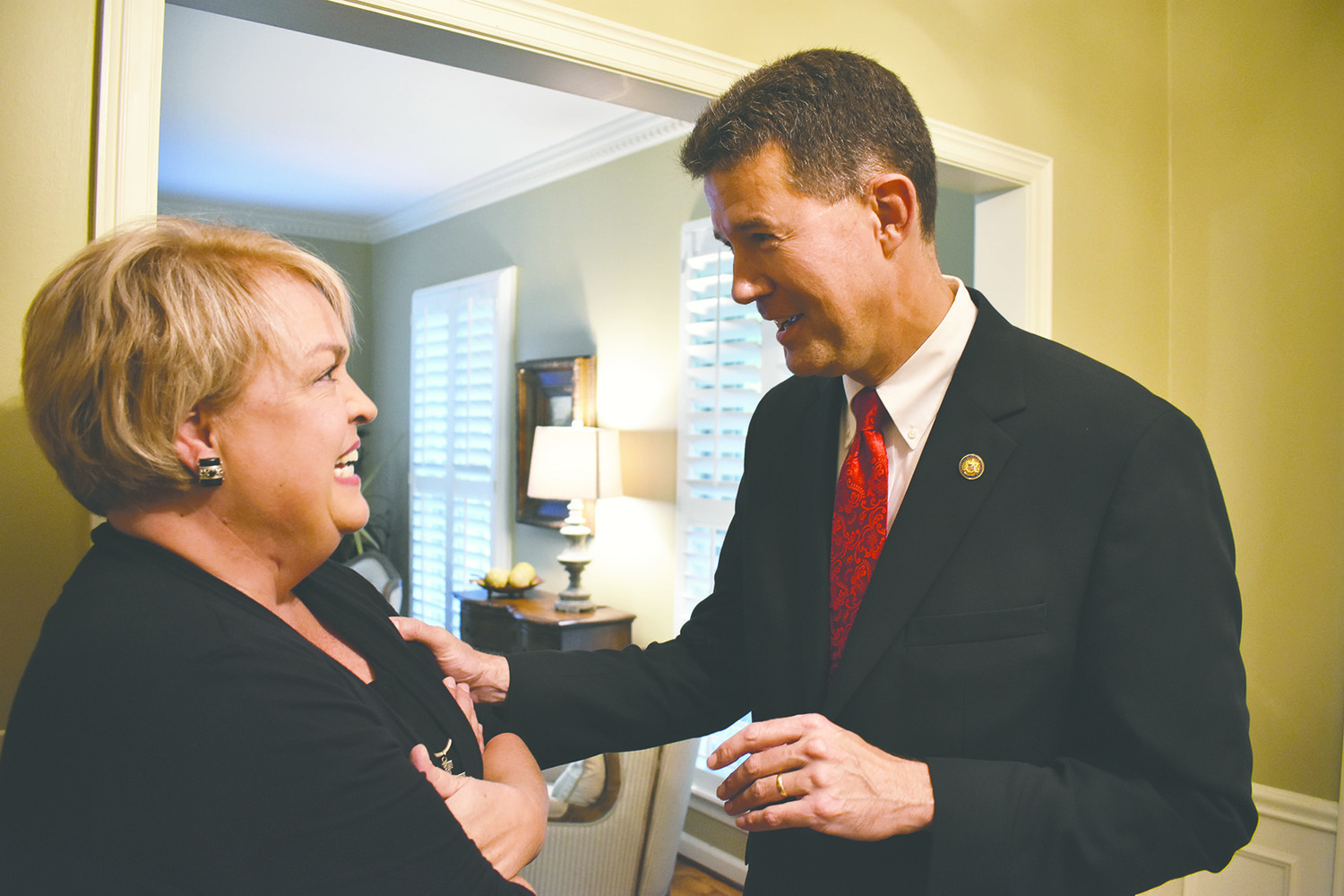 Secretary of State John Merrill, right, shares a moment with state Rep. Connie Rowe, R-Jasper, at a Jasper residence which hosted a campaign meet-and-greet for Merrill on Monday night.