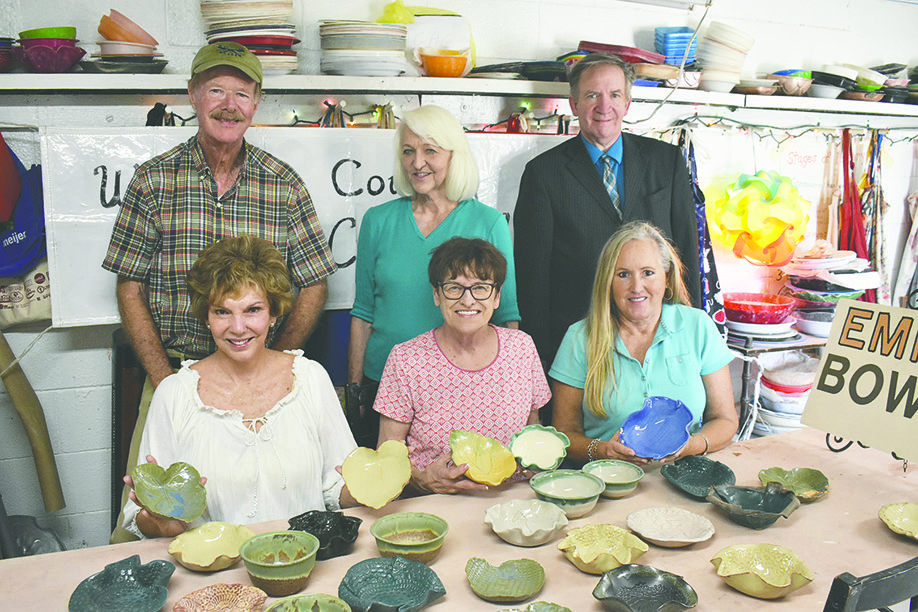 Members of the Winston County Arts Council show off some of the bowls that will be given away at the Oct. 11 Empty Bowl fundraiser for the arts council and the Main Street Ministries Food Bank. Shown are, front row, from left, education coordinator Blythe Welton, potters Sandra Heaven and Diane Sharron; back row, treasurer Larry Welton, vice chairman Theresa Snoddy, and chairman J.D. Snoddy, who also is head of Main Street Ministries.