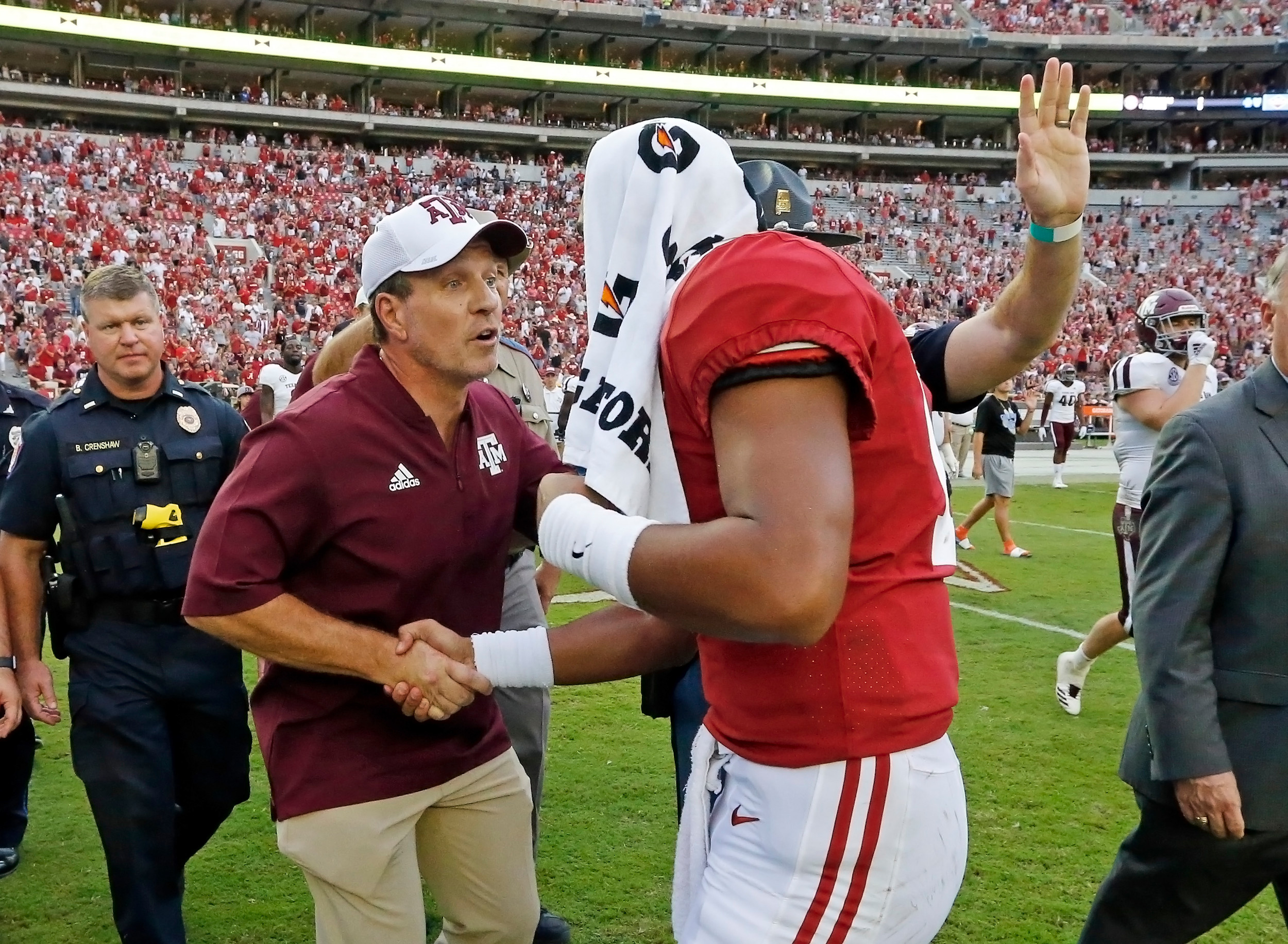 Alabama Crimson Tide quarterback Tua Tagovailoa speaks with Texas A&M Aggies head coach Jimbo Fisher after the game with against the Texas A&M Aggies at Bryant-Denny Stadium.  Jason Clark / Daily Mountain Eagle