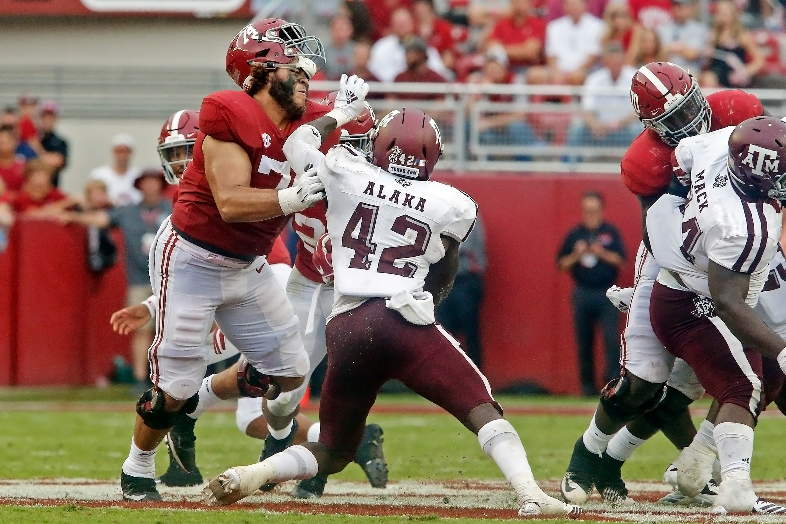 Texas A&M Aggies linebacker Otaro Alaka (42) gets away with some illegal hands to the face of Alabama Crimson Tide offensive lineman Jedrick Wills Jr. (74) during the game with against the Texas A&M Aggies at Bryant-Denny Stadium.  Jason Clark / Daily Mountain Eagle