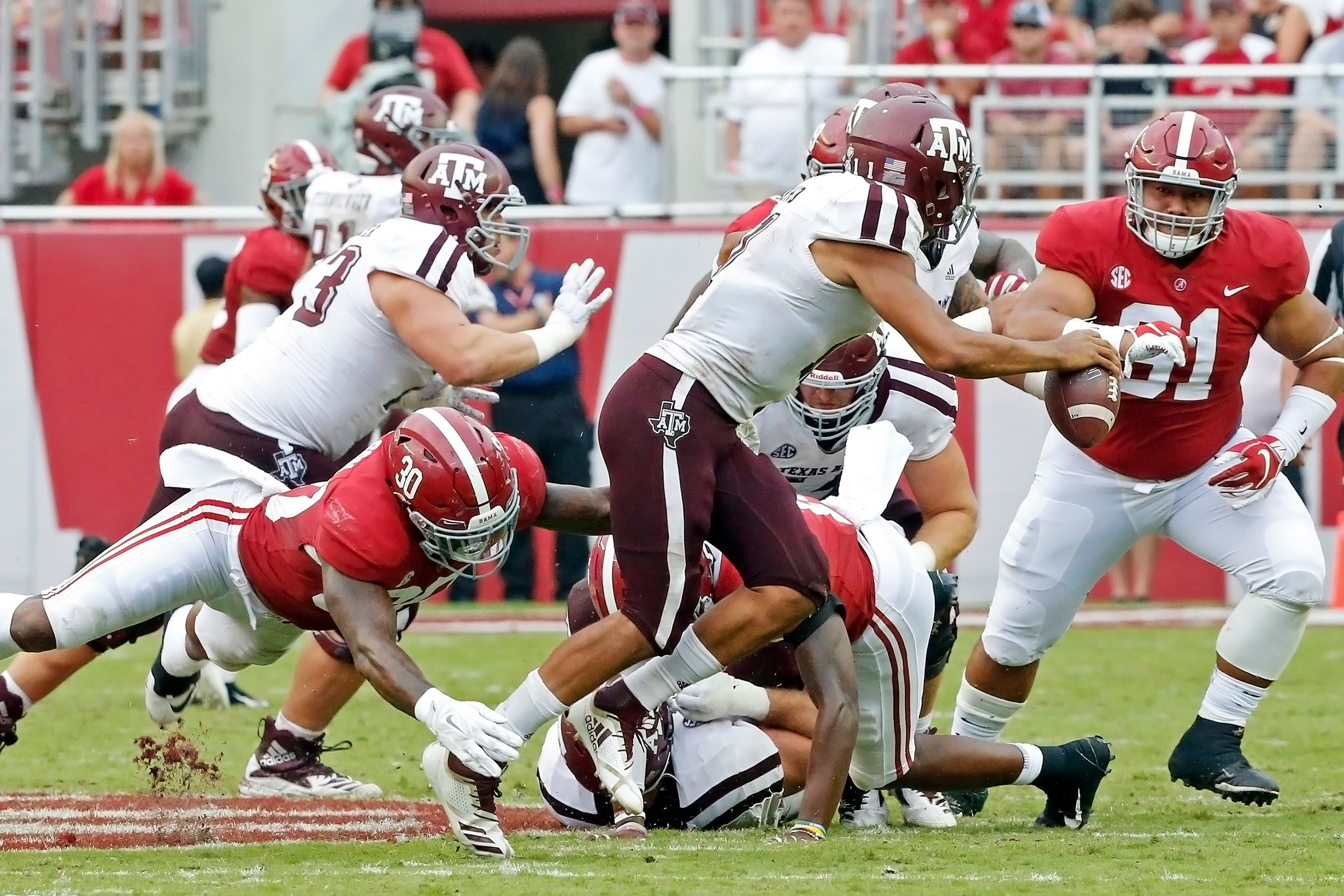 Alabama Crimson Tide linebacker Mack Wilson (30) sacks Texas A&M Aggies quarterback Kellen Mond (11) during the game with against the Texas A&M Aggies at Bryant-Denny Stadium.  Jason Clark / Daily Mountain Eagle