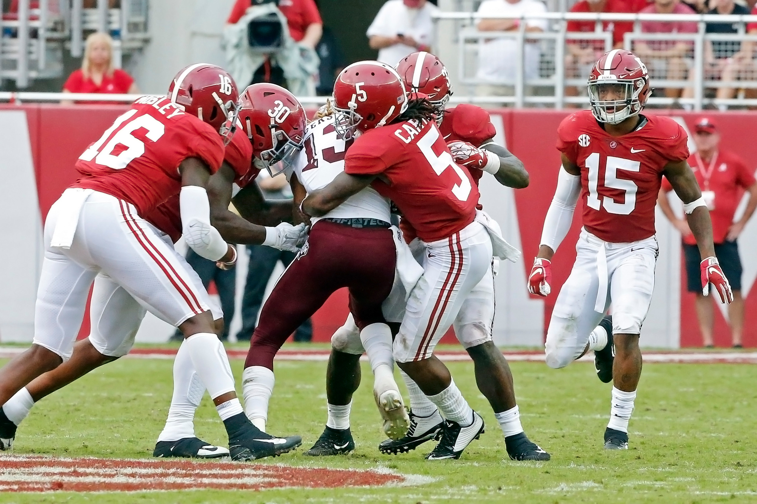 The Alabama Crimson Tide defense makes a stop during the game with against the Texas A&M Aggies at Bryant-Denny Stadium.  Jason Clark / Daily Mountain Eagle