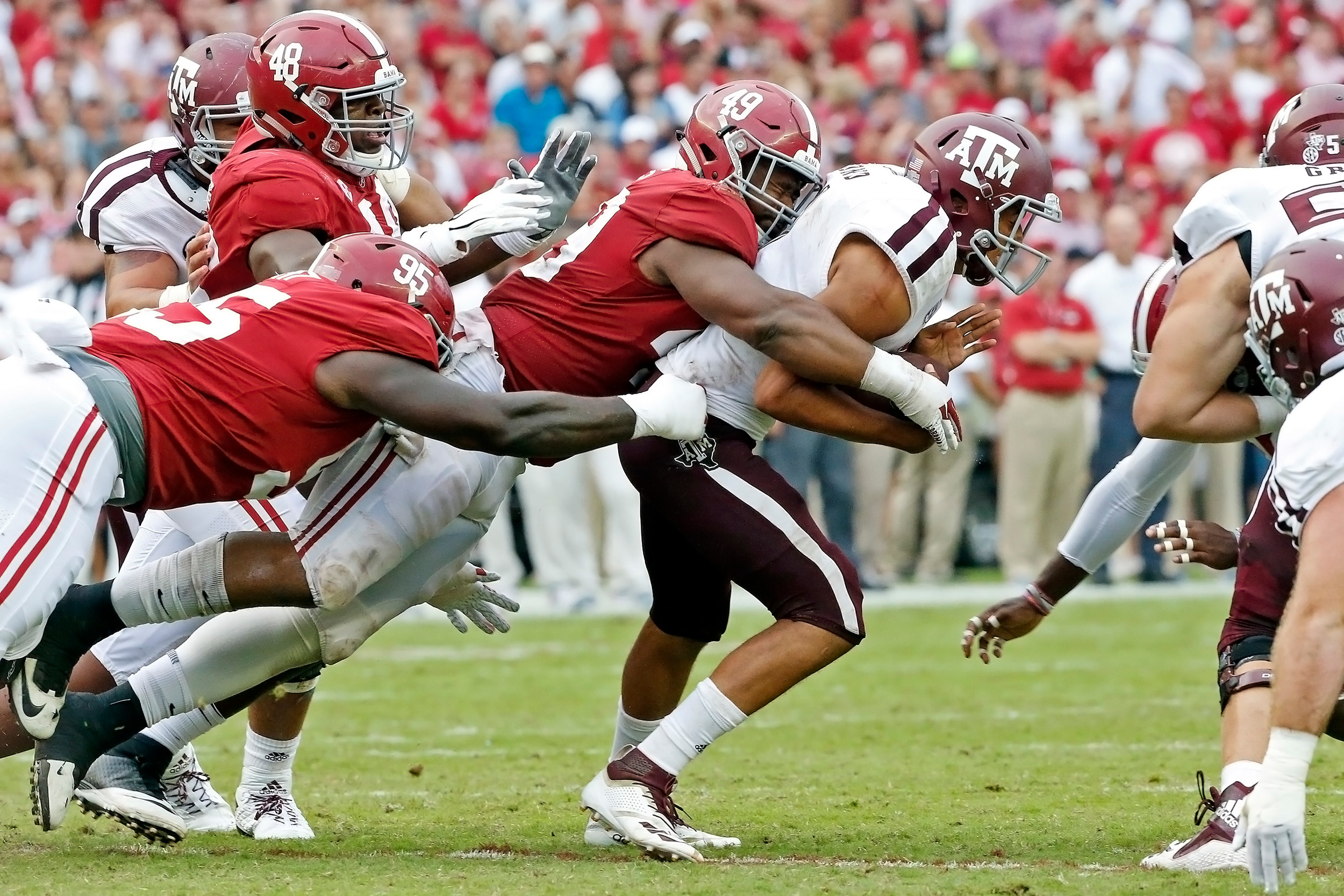 Alabama Crimson Tide defensive lineman Isaiah Buggs (49) tackles Texas A&M Aggies quarterback Kellen Mond (11) during the game with against the Texas A&M Aggies at Bryant-Denny Stadium.  Jason Clark / Daily Mountain Eagle