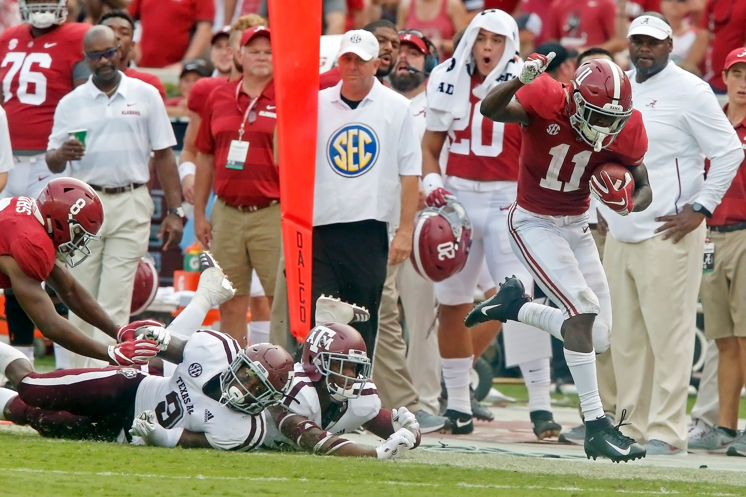 Alabama Crimson Tide wide receiver Henry Ruggs III (11) tip-toes the sideline before rushing to the end zone for a touchdown during the game with against the Texas A&M Aggies at Bryant-Denny Stadium.  Jason Clark / Daily Mountain Eagle